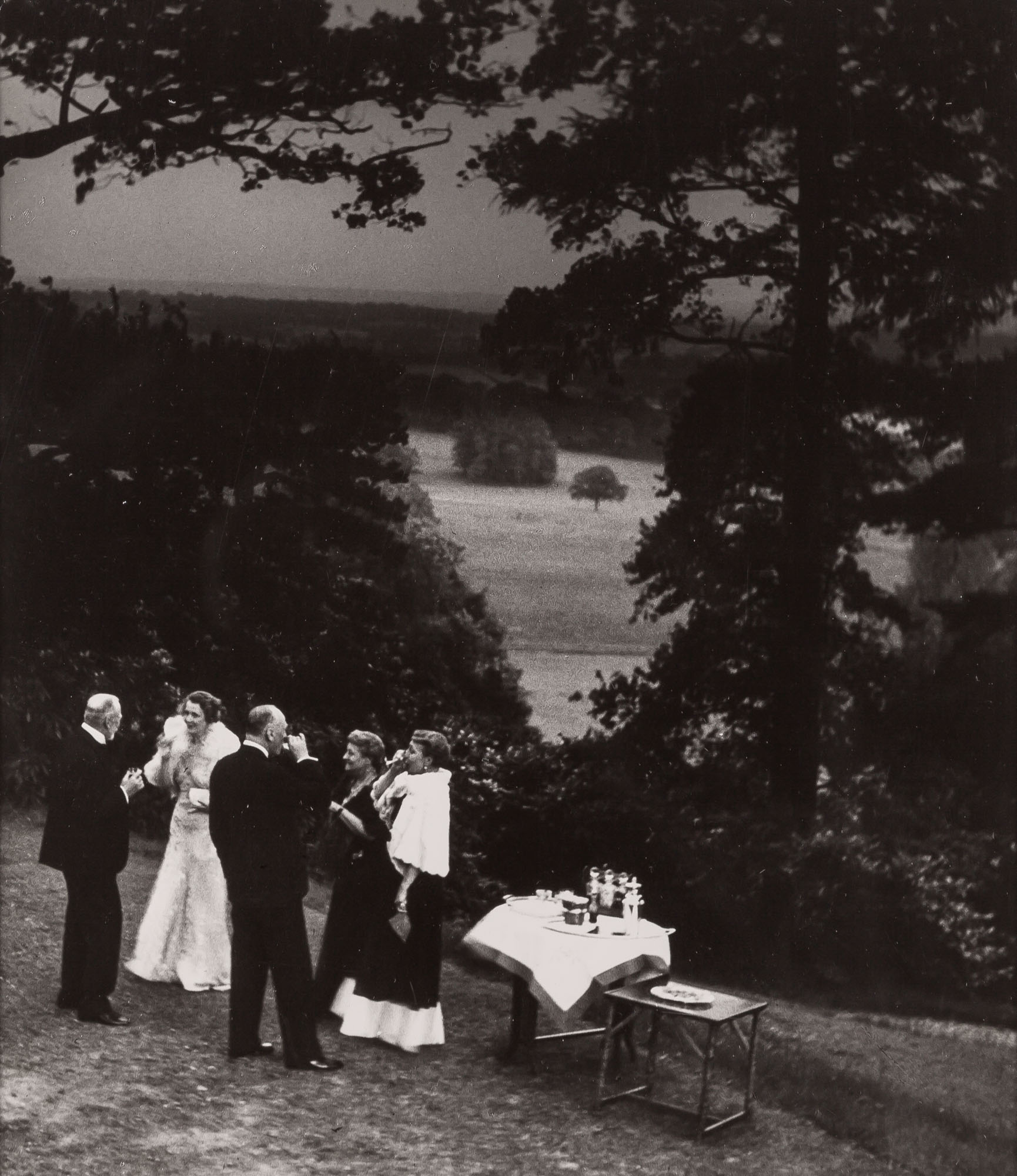 Lot image - BRANDT, BILL (1904-1983)  In a Surrey garden, cocktails before dinner,