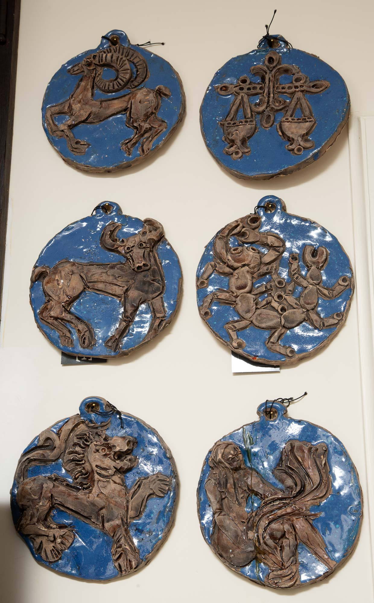 Lot image - Set of Twelve Italian Blue Glazed Earthenware Zodiac Tile Plaques