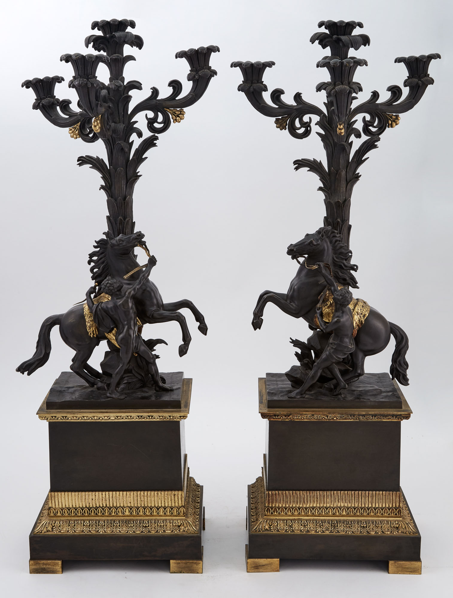 Lot image - Pair of Restauration Gilt and Patinated Bronze Marly Horse Four-Light Candelabra