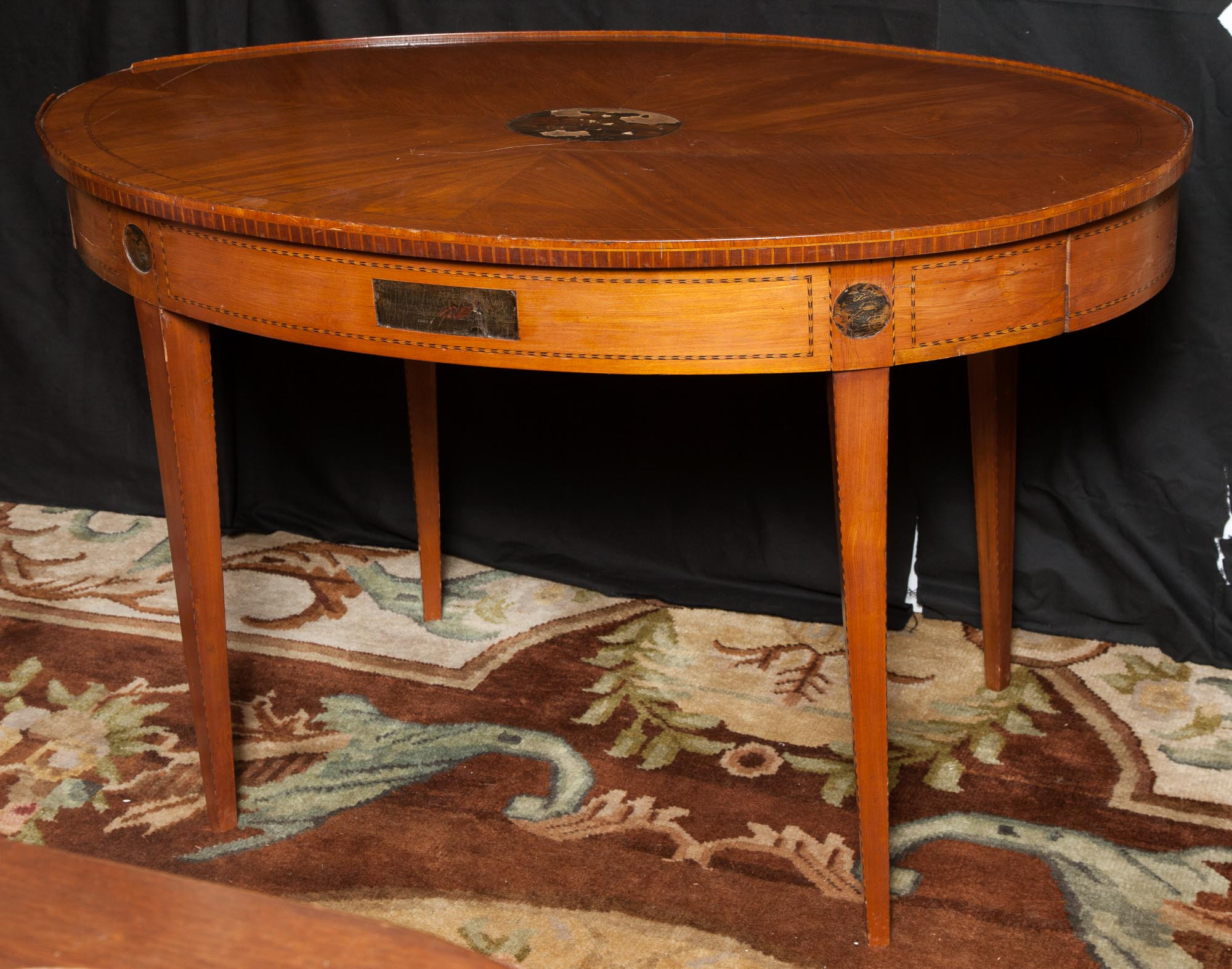 Lot image - Dutch Neoclassical Style Walnut and Marquetry Oval Table with Lacquer-Inset Panels