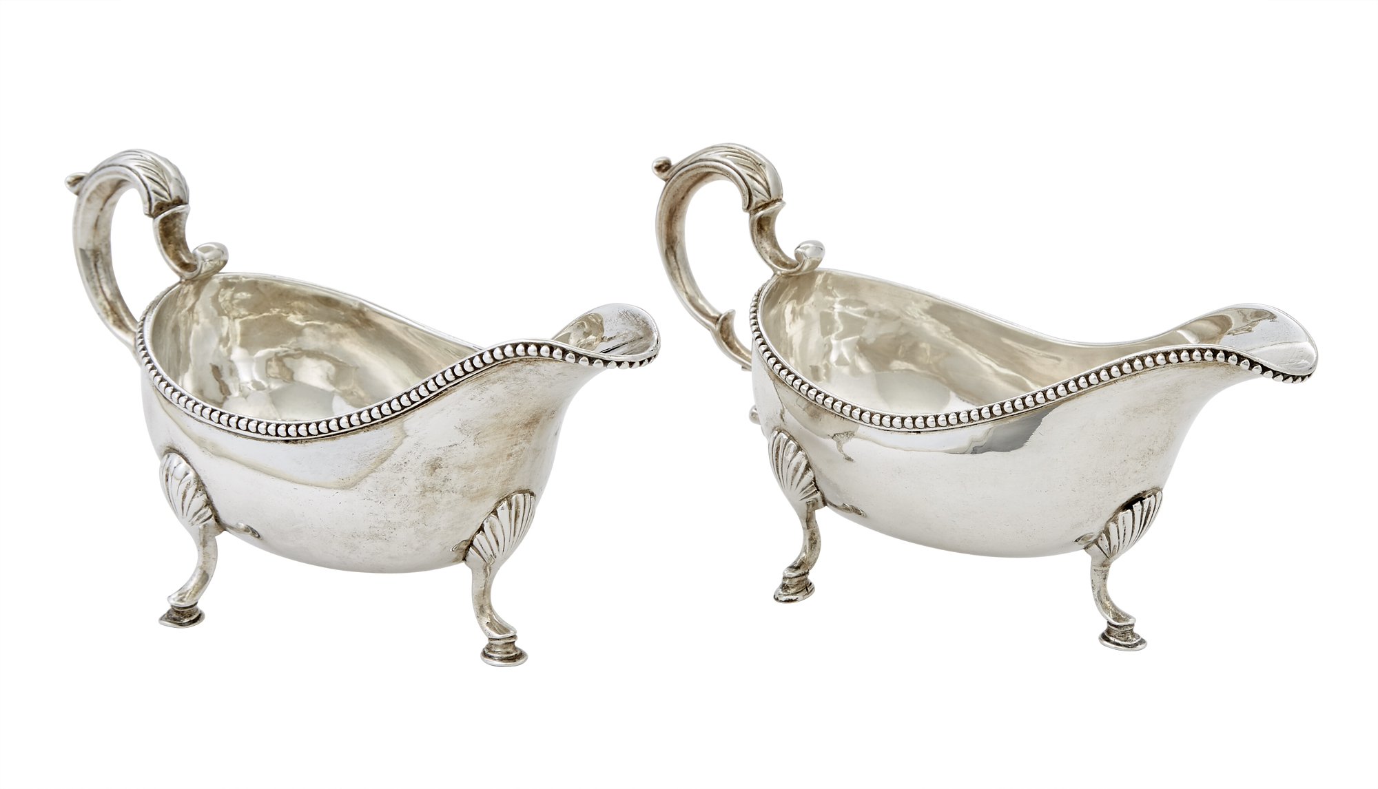 Lot image - Pair of George III Irish Sterling Silver Sauceboats