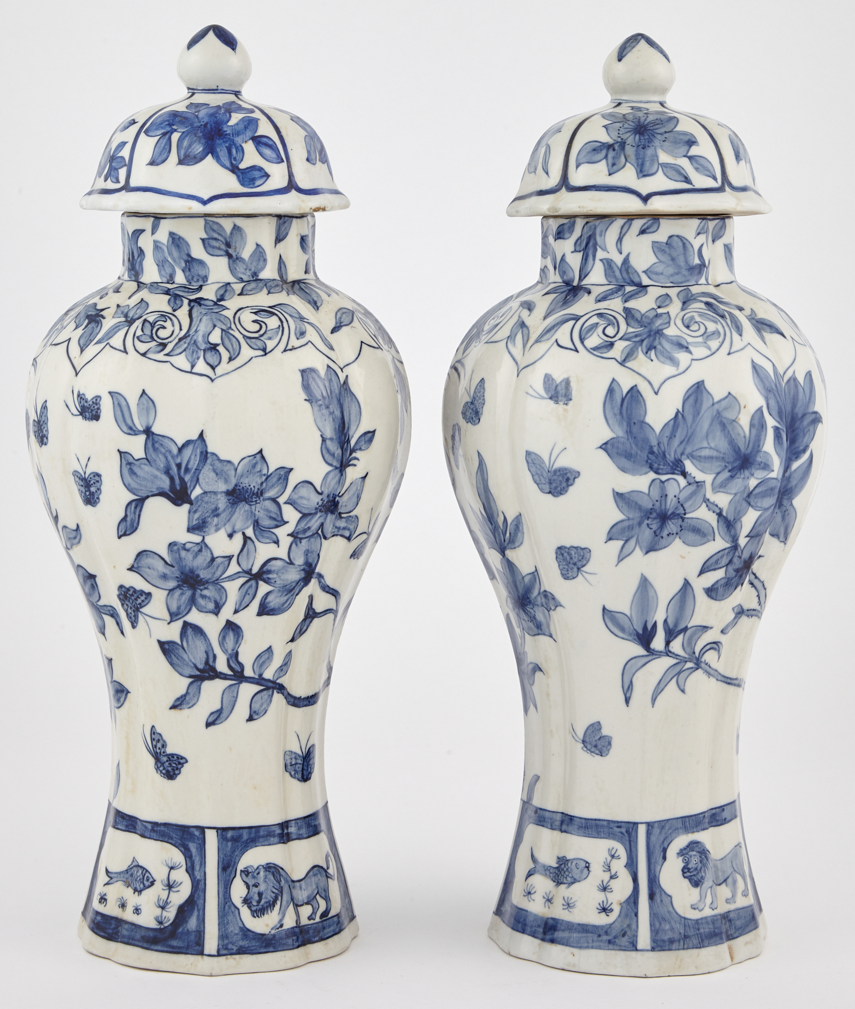 Lot image - Pair of Chinese Blue and White Porcelain Baluster Vases and Covers