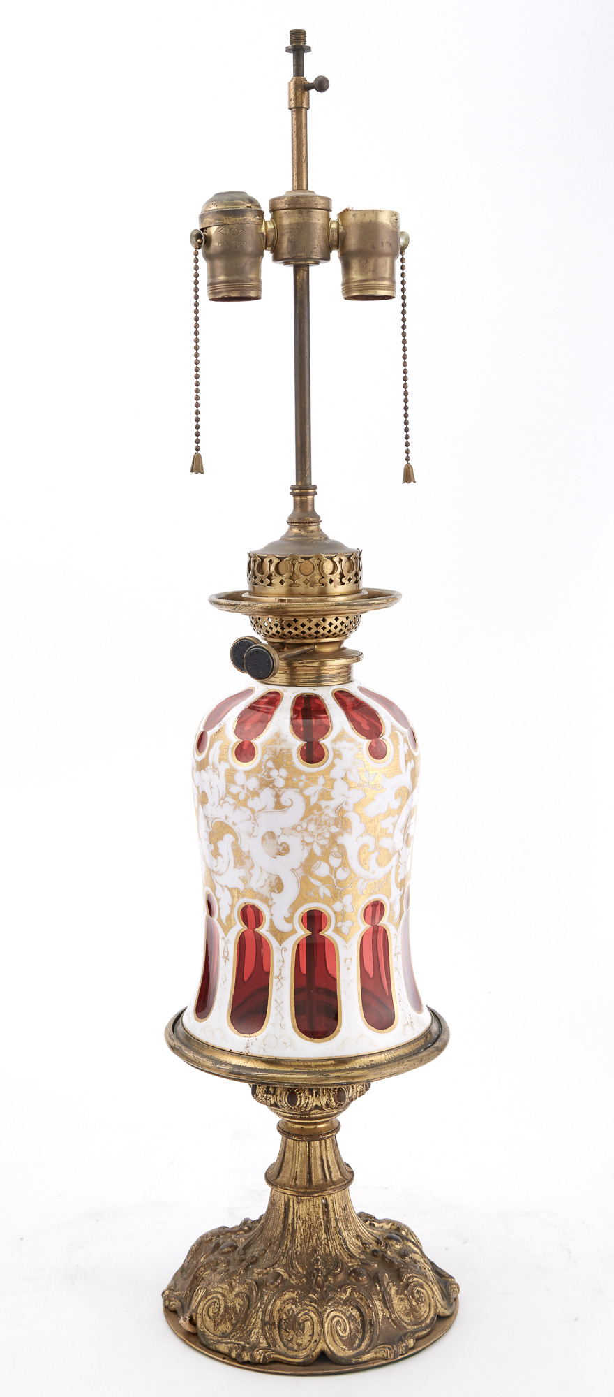 Lot image - Bohemian Style Gilt-Metal Mounted and Gilt Decorated Opaque White and Ruby Overlay Glass Lamp
