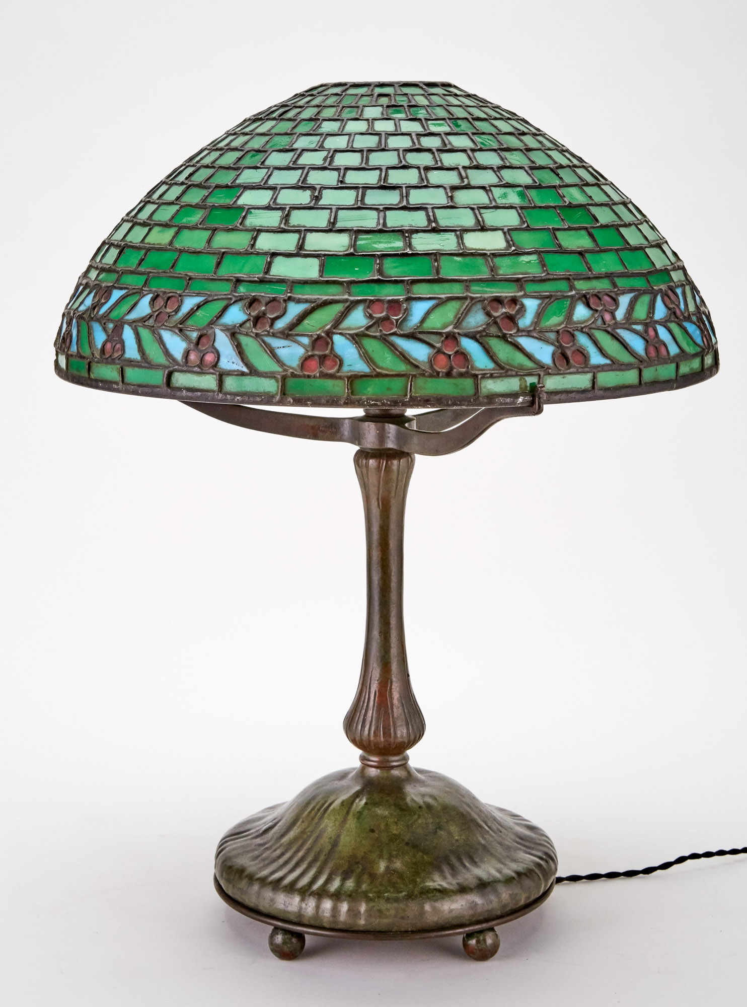 Lot image - American Patinated Metal and Leaded Glass Geometric and Leaf and Berries Table Lamp