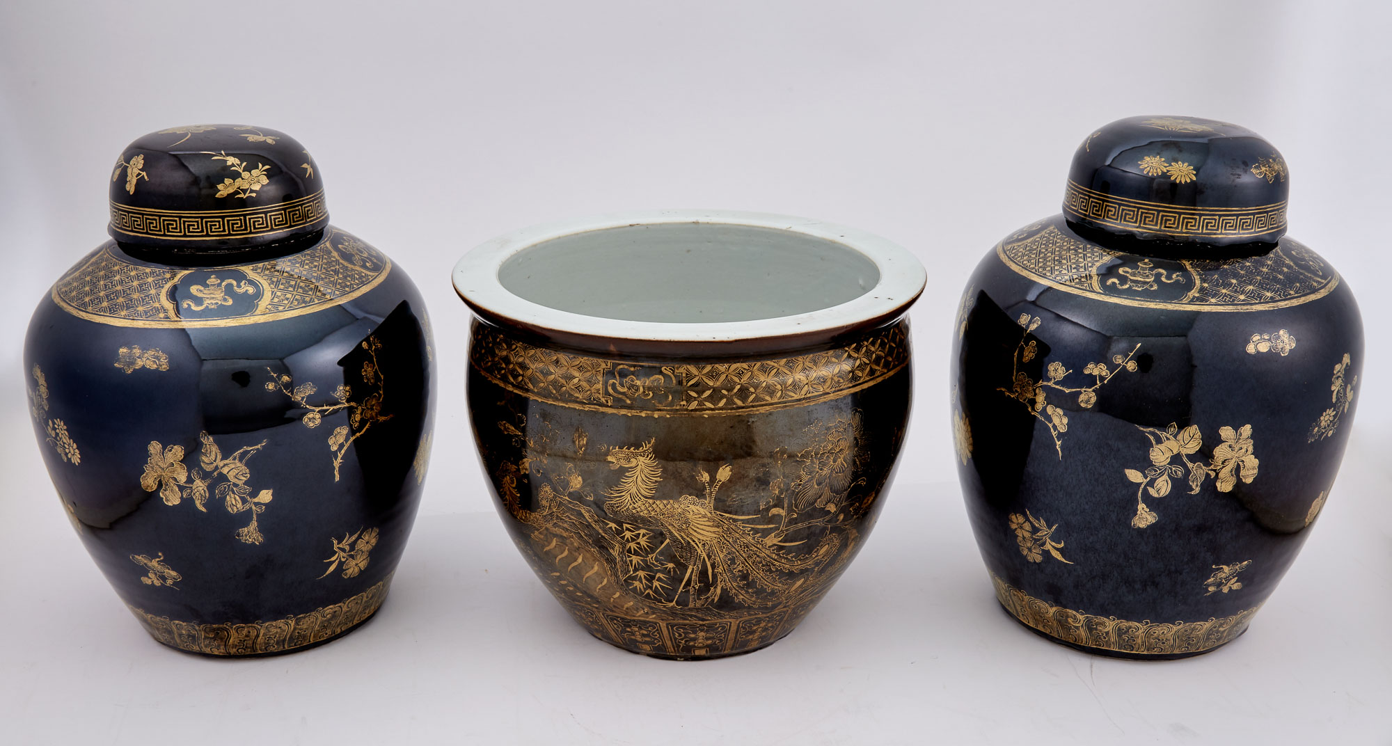 Lot image - Pair of Chinese Gilt-Decorated Mirror Black Ground Porcelain Jars and Covers