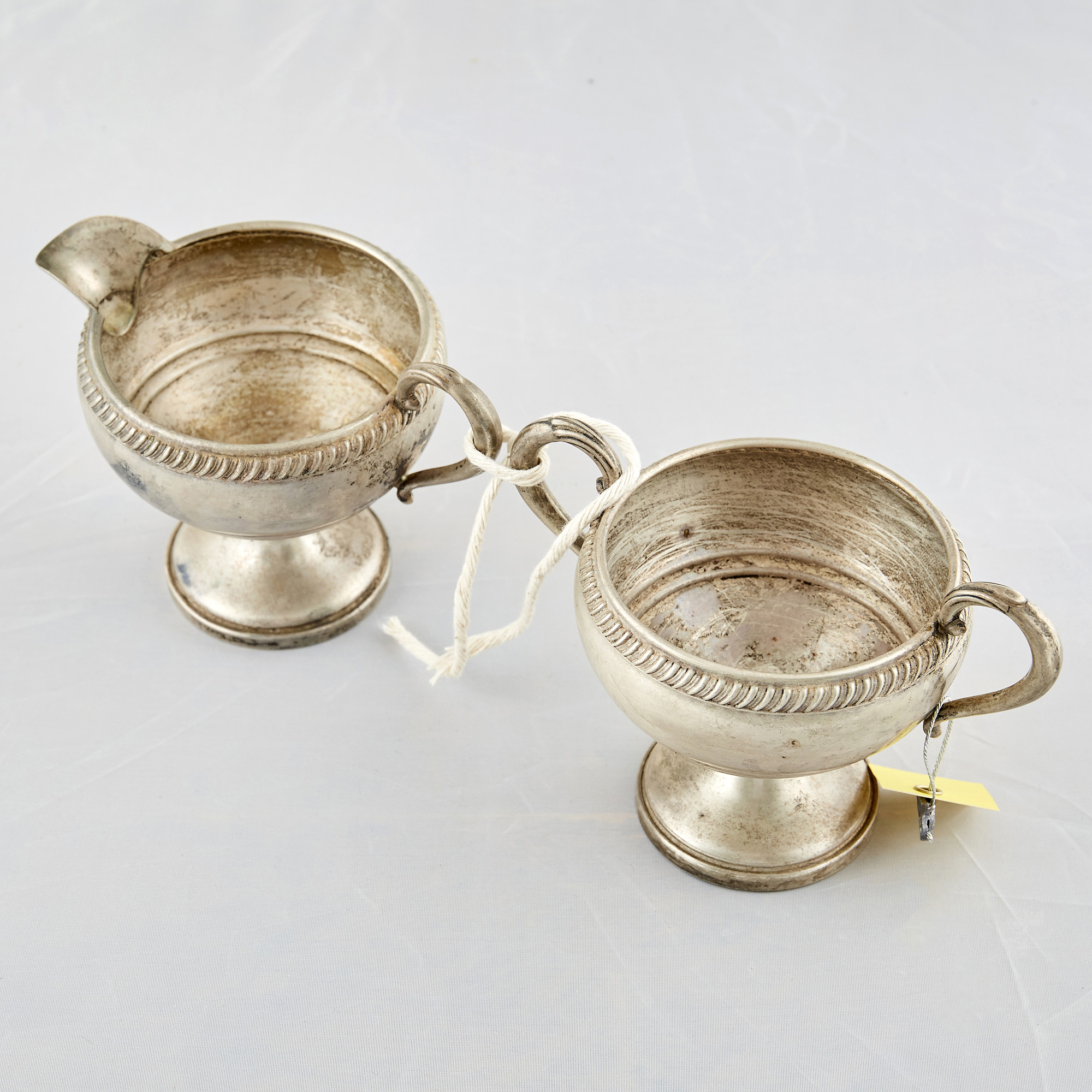 Lot image - Silver Bowl and Creamer, 6 ozs., weighted and damaged