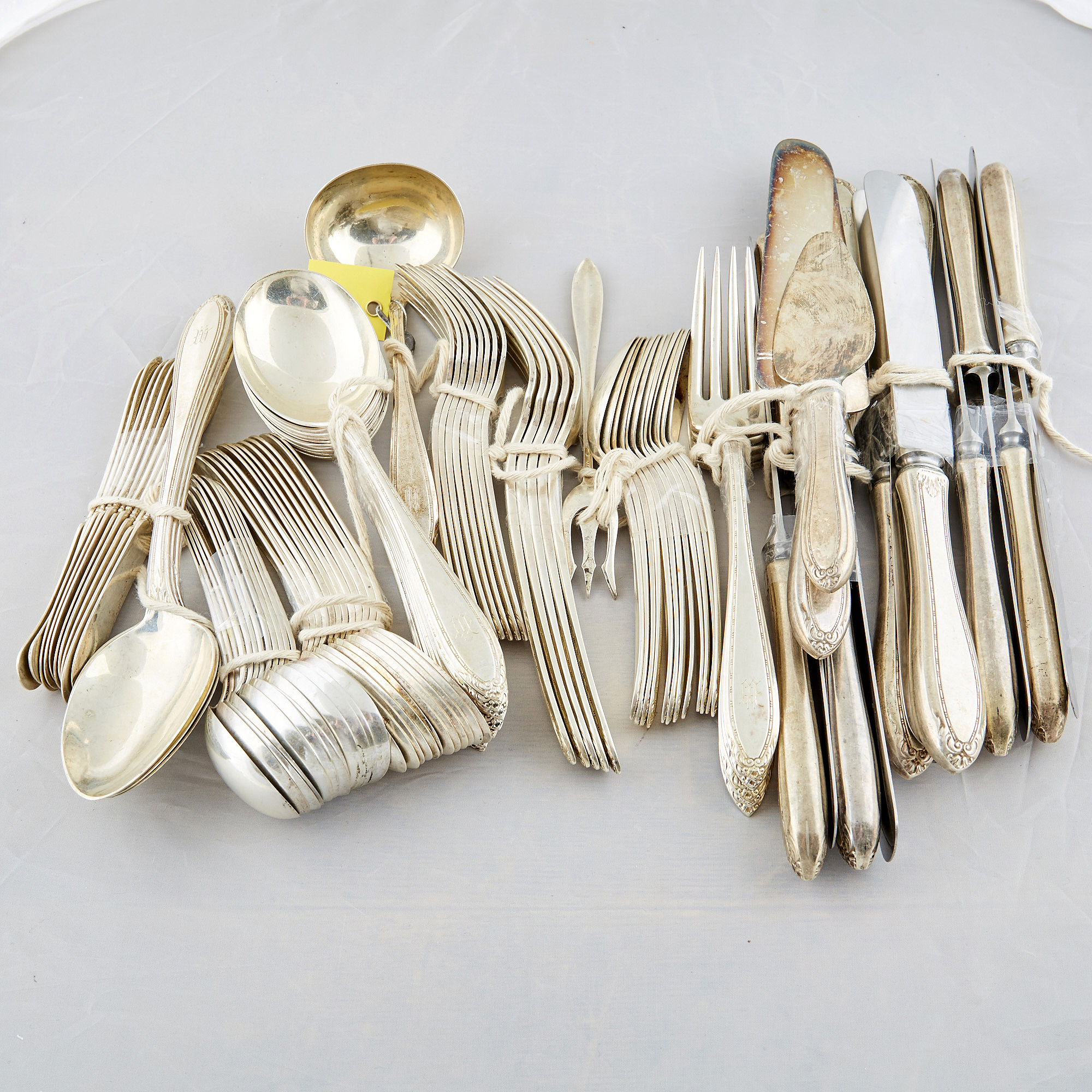 Lot image - 80 Pieces of Silverware, 82 ozs., 14 handles