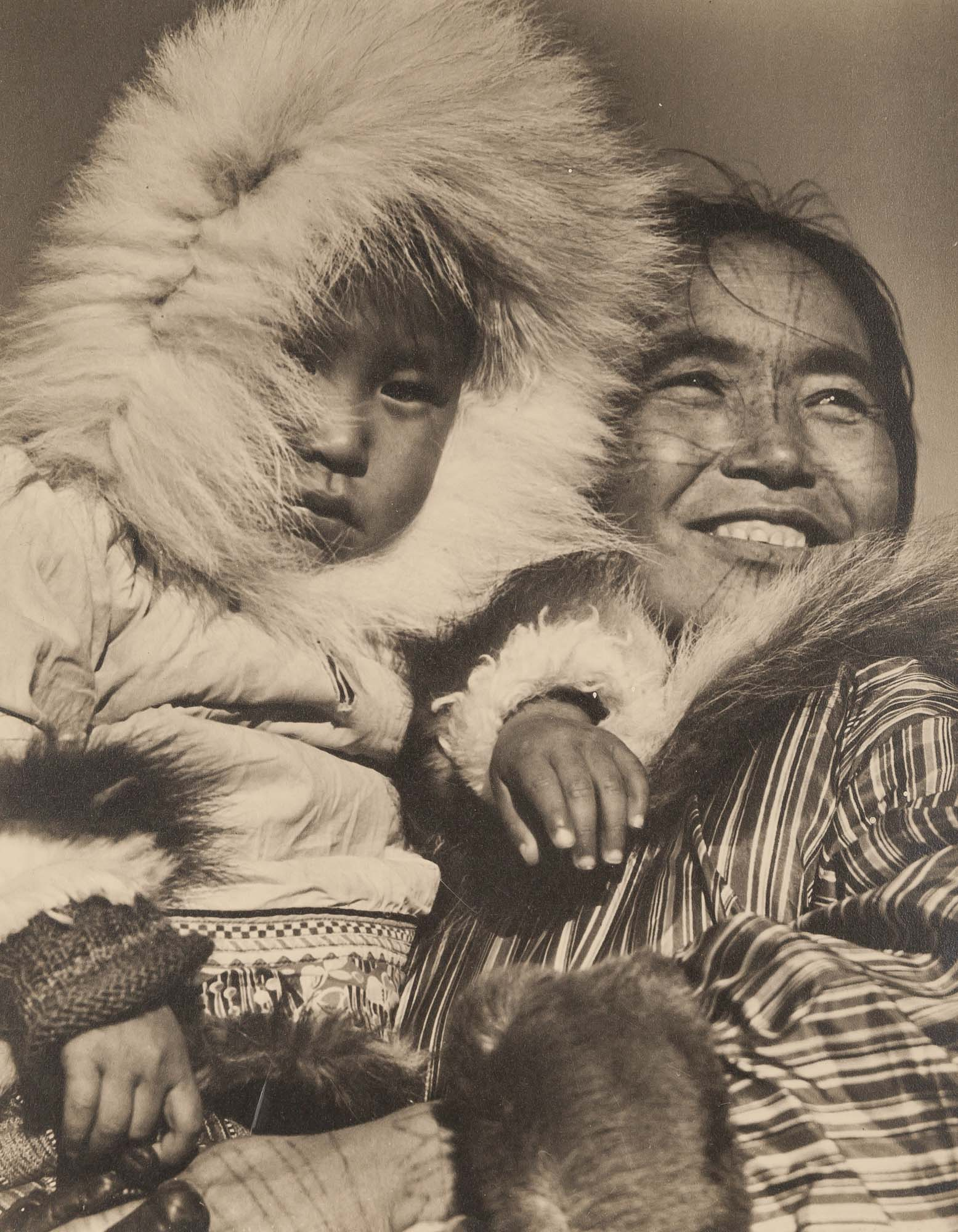 Lot image - BOURKE-WHITE, MARGARET (1902-1971)  [Keptanna with her baby Nalsuyals, Eskimos, Coppermine, Northwest Territories, Canada,
