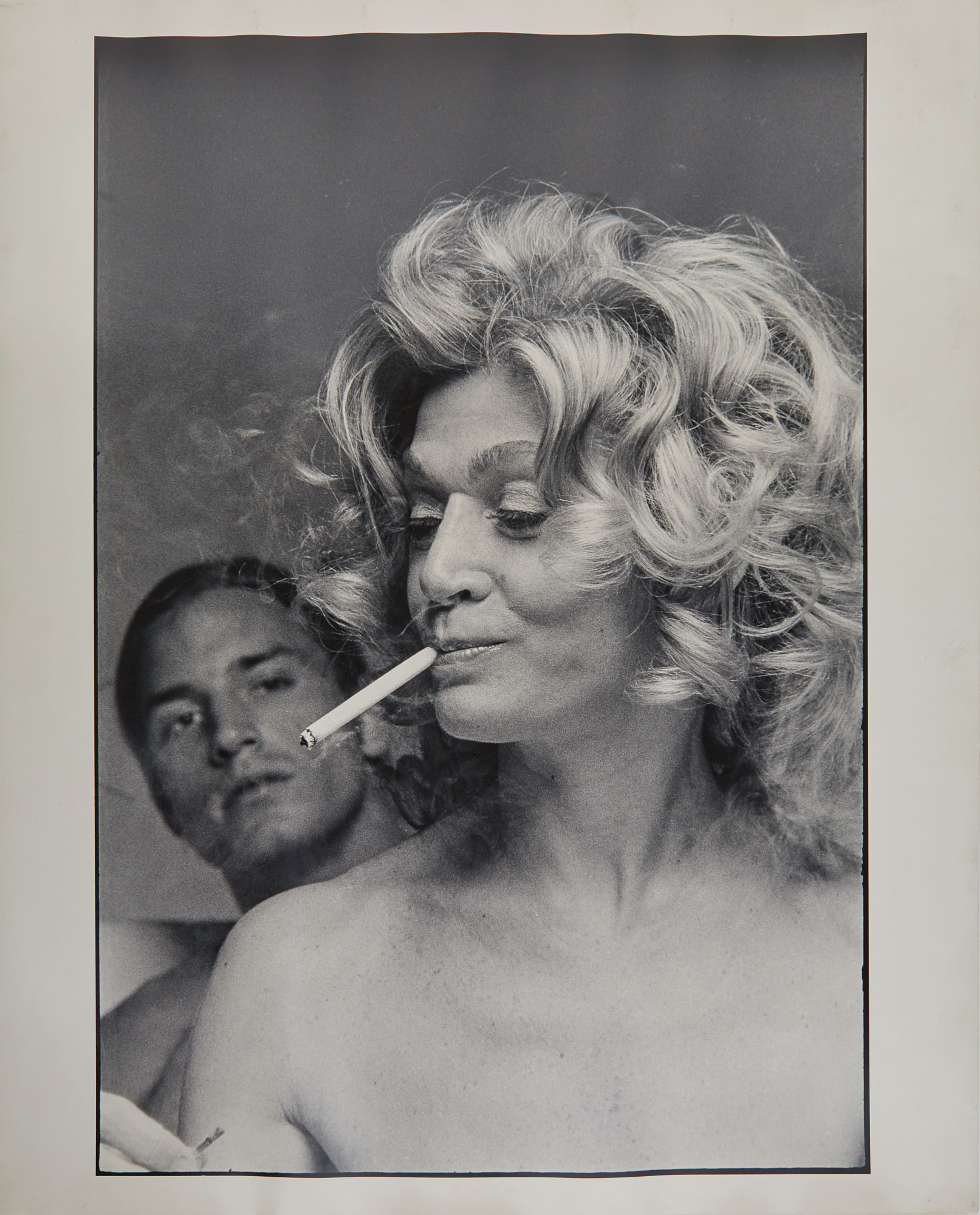 Lot image - [WARHOL, ANDY and DALLESANDRO, JOE]  SCAVULLO, FRANCIS. [Joe Dallesandro and Sylvia Miles in Heat