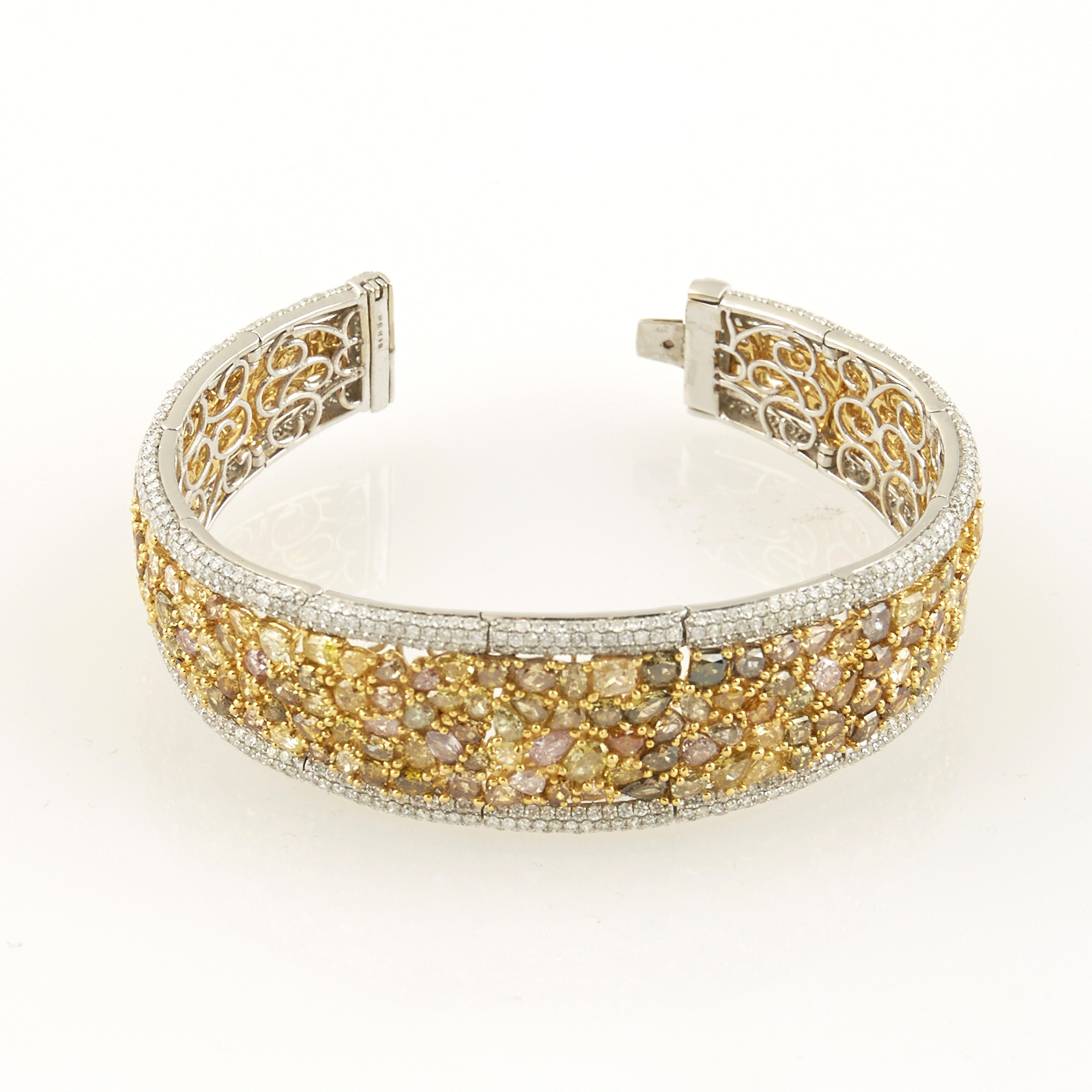 Lot image - Diamond Rigid Bracelet, 948 diamonds about 26.00 cts., 18K 38 dwt., stone missing