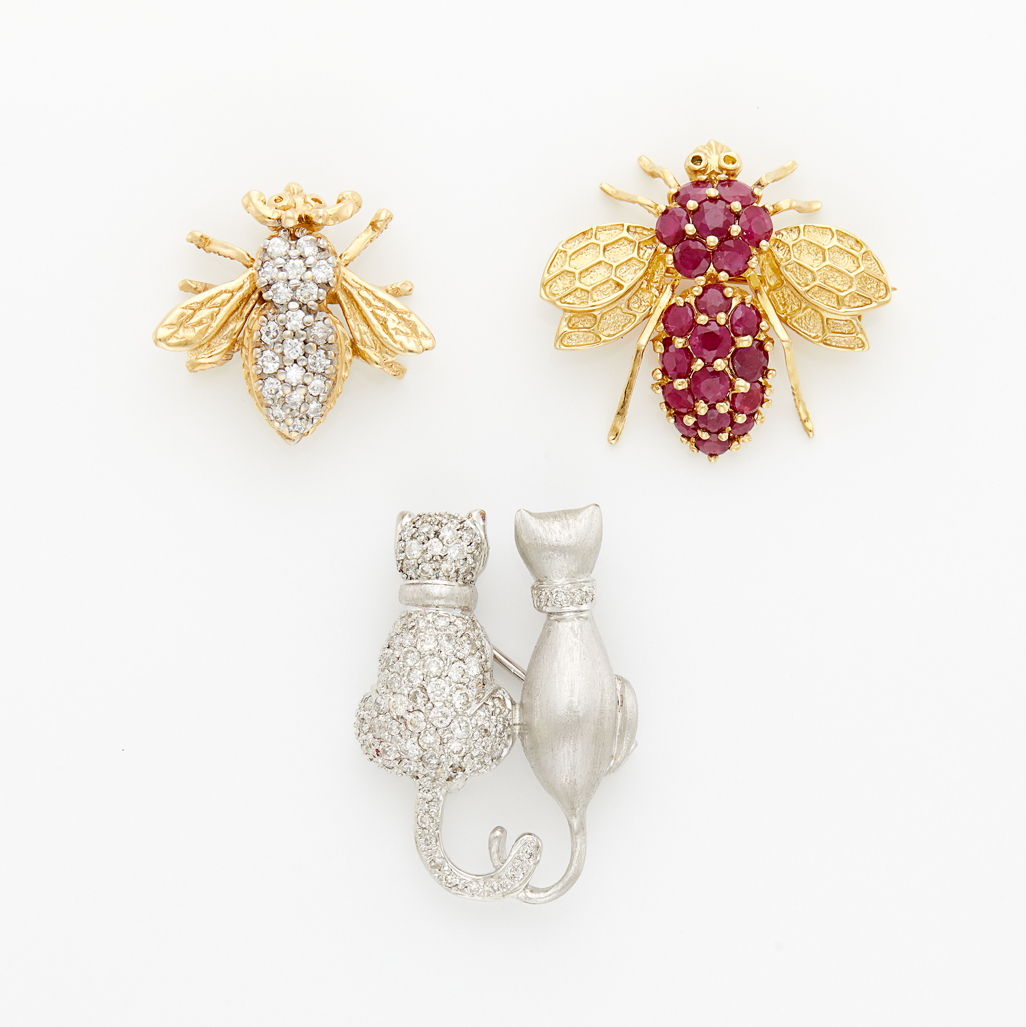 Lot image - Gold and Ruby Insect Pin, Gold and Diamond Insect Pin and White Gold and Diamond Love Cat Pendant-Brooch