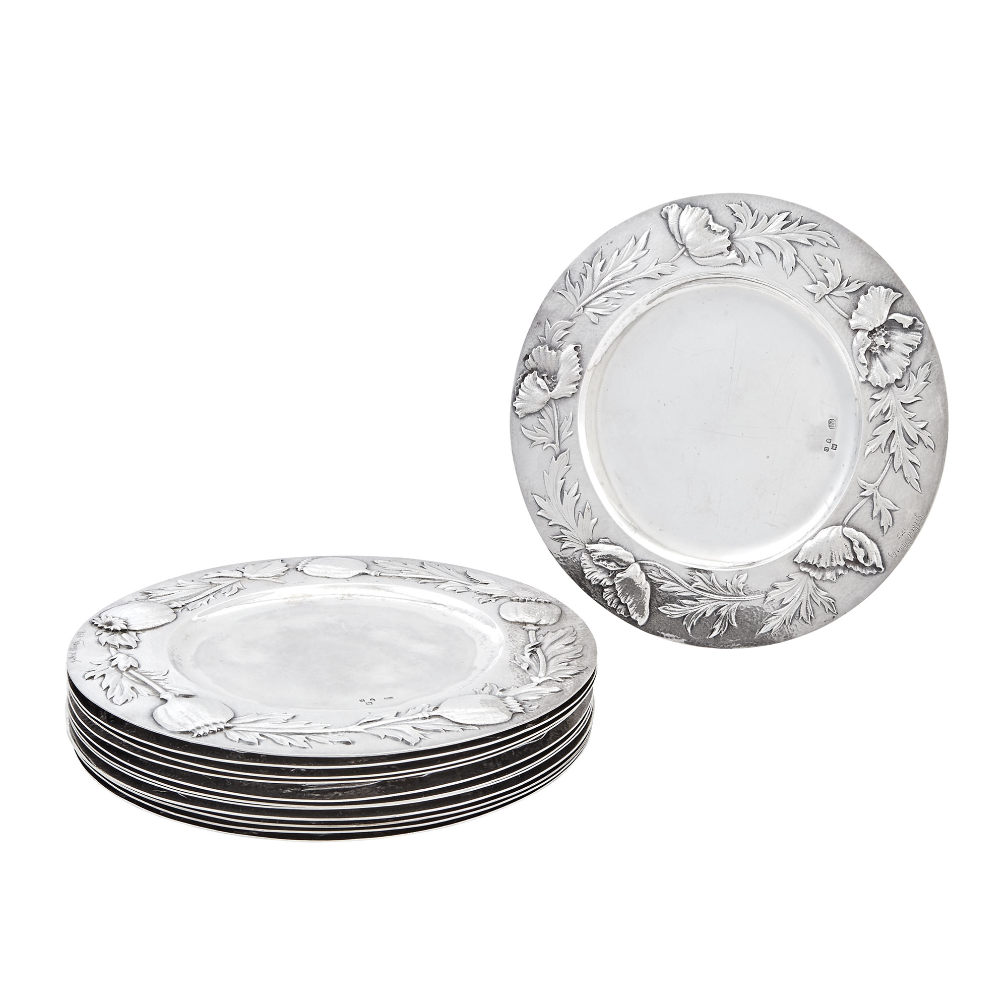 Lot image - Set of Twelve English Sterling Silver Chargers    Gilbert Marks, London, 1897  Each circular, the border embossed with floral specimen and incised signature and date 1898.  Diameter 8 5/8 inches, total approximately 122 ounces.