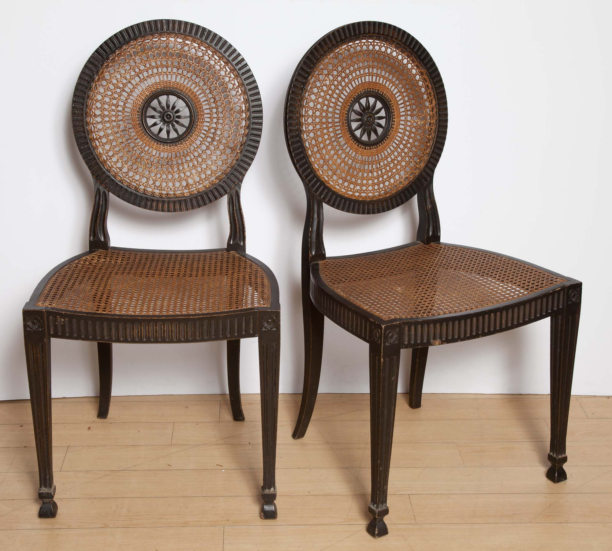 Lot image - Pair of George III Style Ebonized and Caned Side Chairs