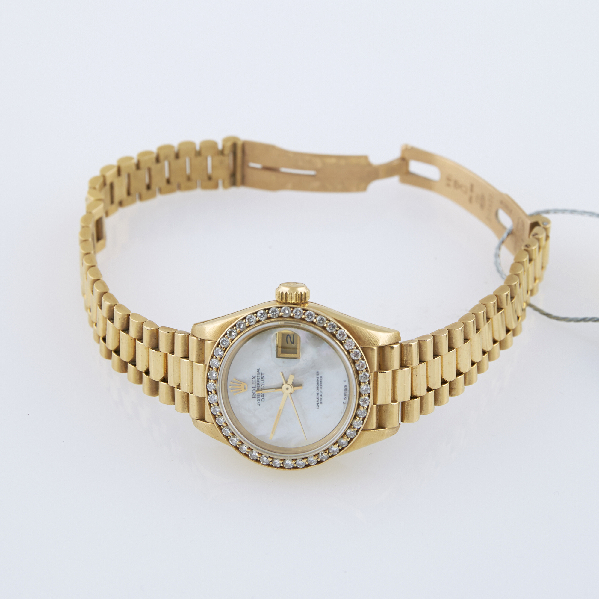 Lot image - Ladys Diamond Bracelet Watch, 40 diamonds about 0.60 ct., 29 Jewels, Rolex, President, 18K 46 dwt.  all