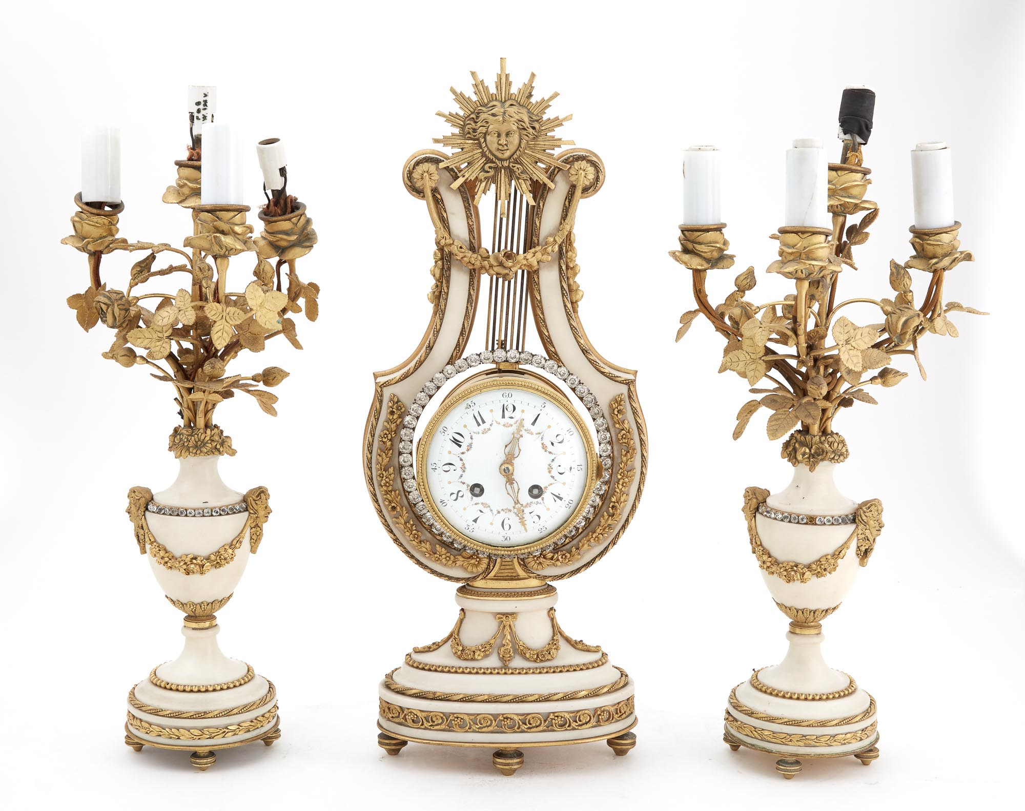 Lot image - Louis XVI Style Gilt-Metal and White Marble Three-Piece Lyre-Form Clock Garniture