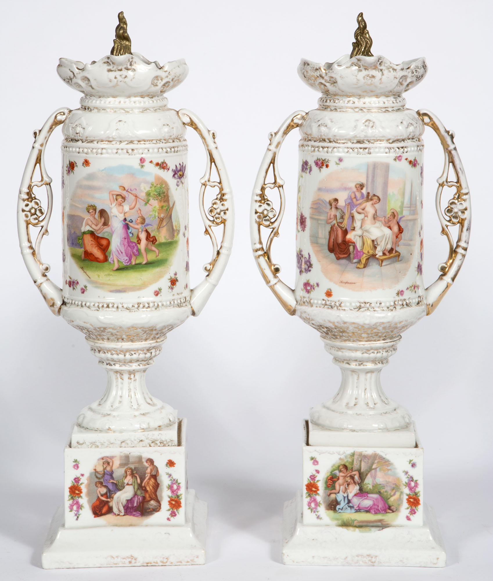 Lot image - Pair of Continental Gilt-Metal Mounted Gilt and Transfer Print Decorated Porcelain Two-Handled Covered Urns on Pedestals