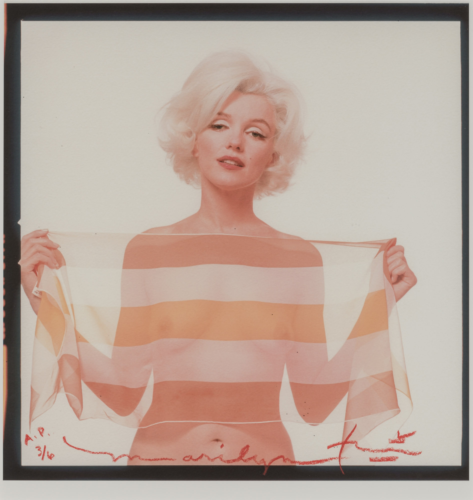 Lot image - STERN, BERT (1929-2013)  Marilyn Monroe with a striped scarf,