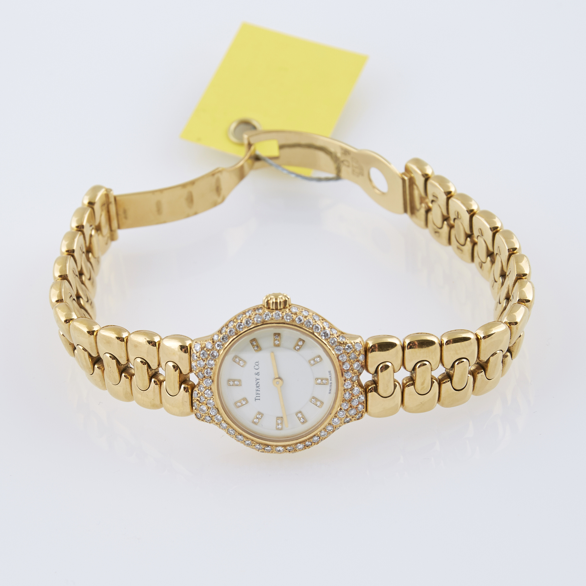 Lot image - Ladys Diamond Bracelet Watch, 98 diamonds about 1.00 ct., Tiffany & Co., Quartz, 18K 47 dwt. all