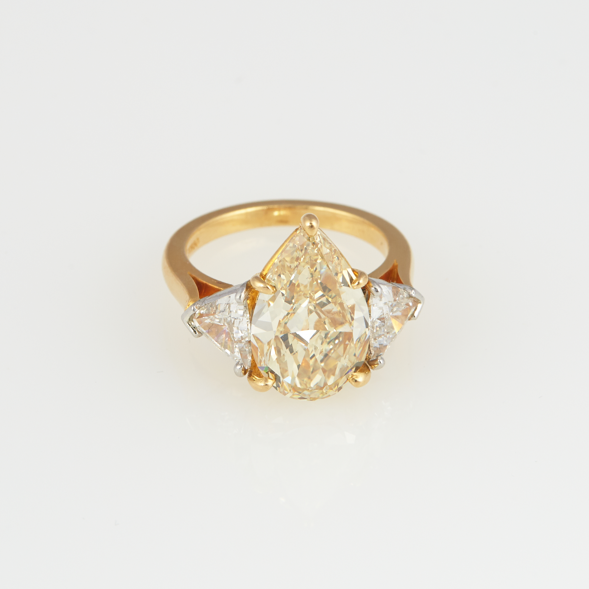 Lot image - Diamond Engagement Ring, 3 diamonds, center stone about 5.12 cts., with GIA report