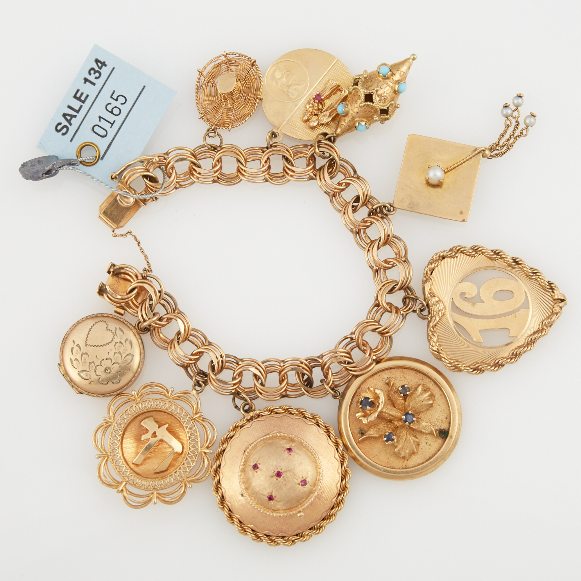 Lot image - Gold Charm Bracelet with 9 gold, stone, bead and metal charms attached, 14K and Metal 55 dwt. all