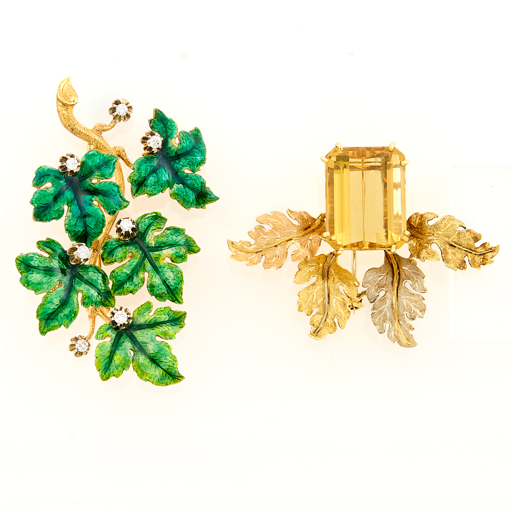 Lot image - Gold, Silver, Enamel and Diamond En Tremblant Leaf Brooch and Tricolor Gold and Citrine Leaf Brooch
