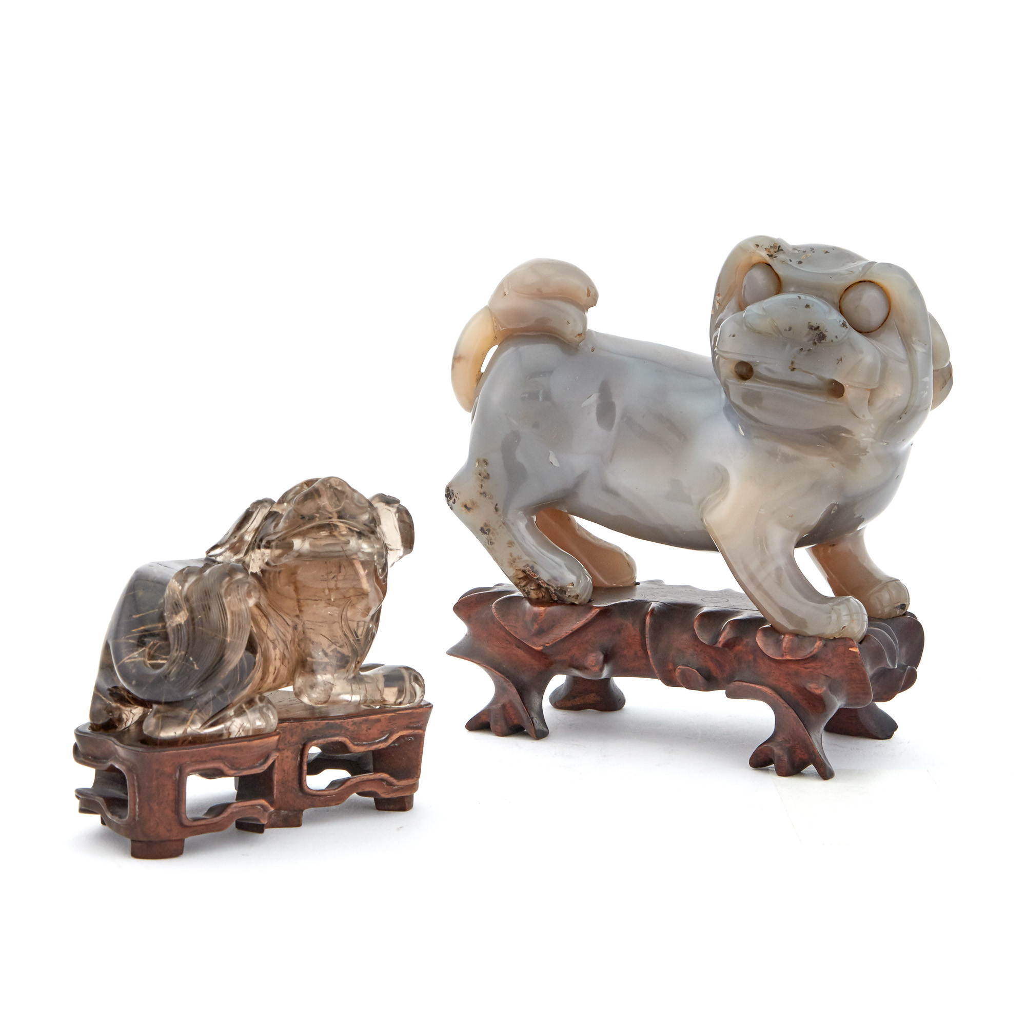 Lot image - Two Chinese Carved Hardstone Figures of Fu Lions