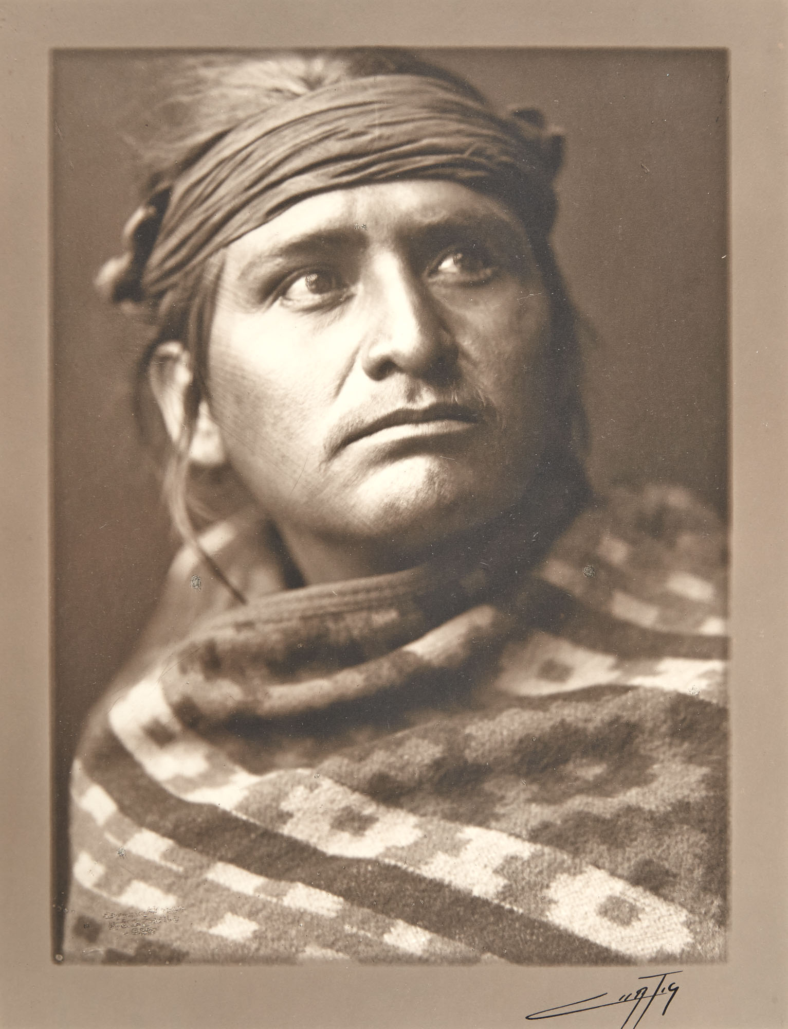Lot image - CURTIS, EDWARD SHERRIFF (1868-1952)  A Chief of the Desert, Navajo
