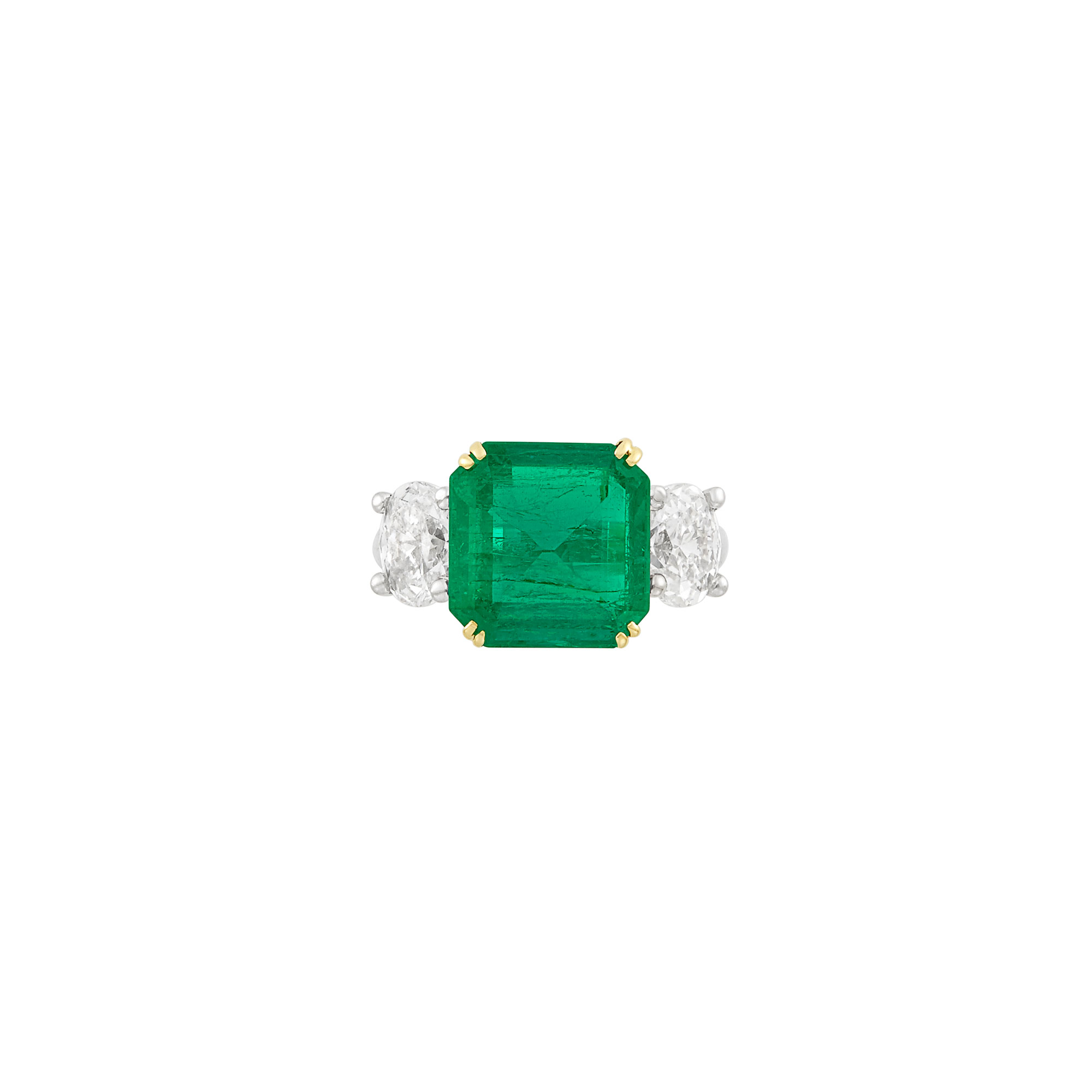 Lot image - Platinum, Gold, Emerald and Diamond Ring