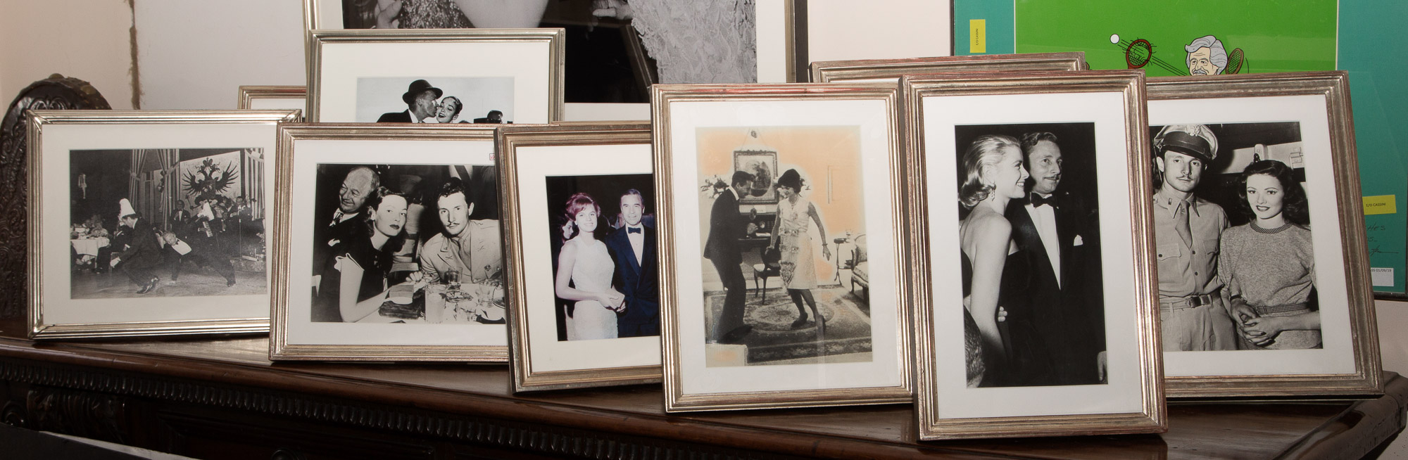 Lot image - [CASSINI-PHOTOGRAPHS]  Group of approximately twenty-two framed photographs depicting Oleg Cassini with the Kennedys, Grace Kelly and others.