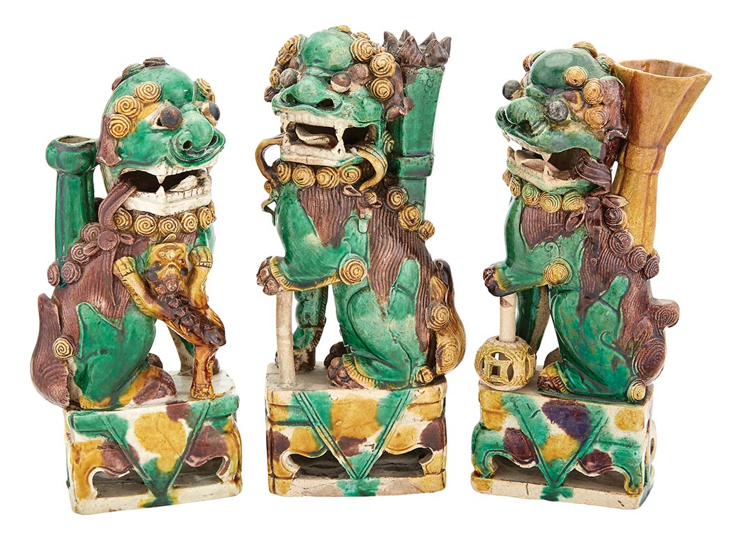 Lot image - Group of Three Chinese Green, Yellow and Aubergine Glazed Taper-Stick Holders