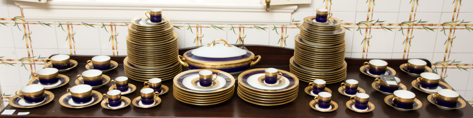 Lot image - Limoges Gilt and Cobalt Decorated Porcelain Dinner Service for Twelve