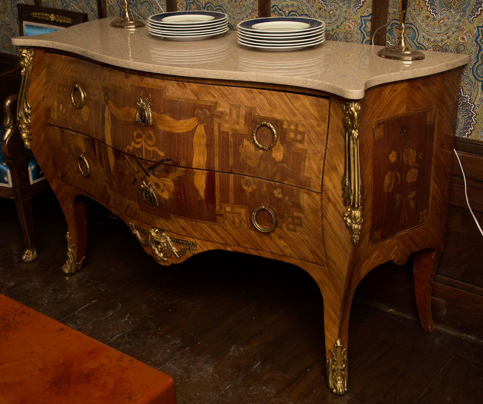 Lot image - Late Louis XV Ormolu-Mounted Tulipwood and Marquetry Bombé Commode