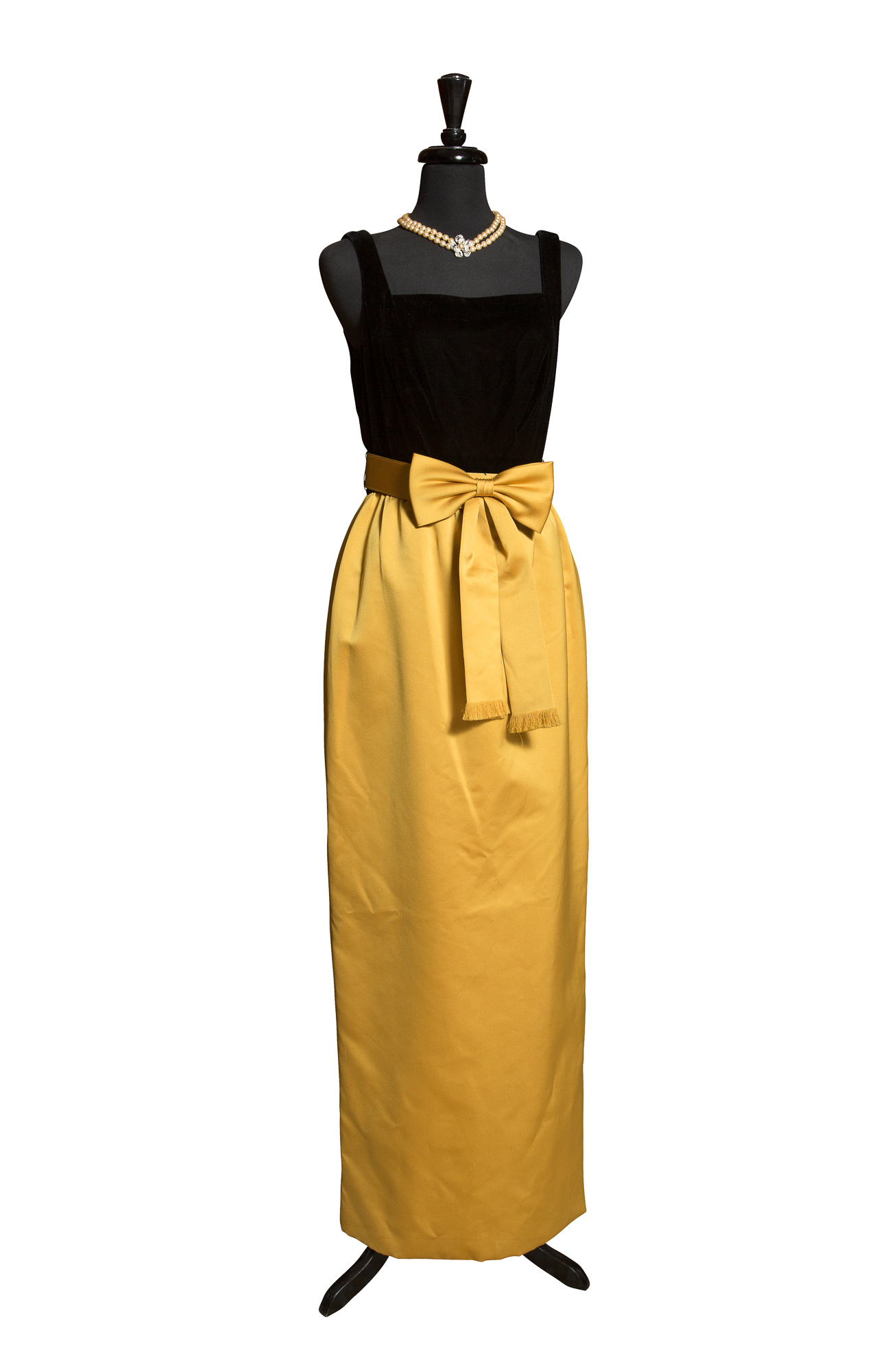 Lot image - [OLEG CASSINI GOWNS]  Group of approximately eight Oleg Cassini designed gowns and dresses, including two replicas of a gown made for Mrs. Kennedy as First Lady.