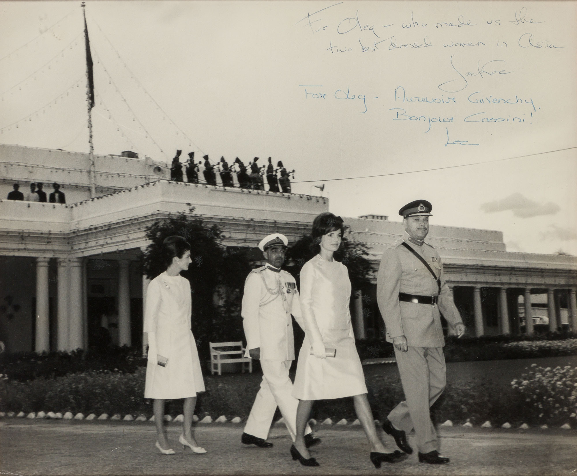 Lot image - KENNEDY, JACQUELINE as FIRST LADY and RADZIWILL, LEE  Double inscribed photograph to Oleg Cassini of the First Lady and Radziwill leaving the Governors House at Peshawar, Pakistan, 1962.