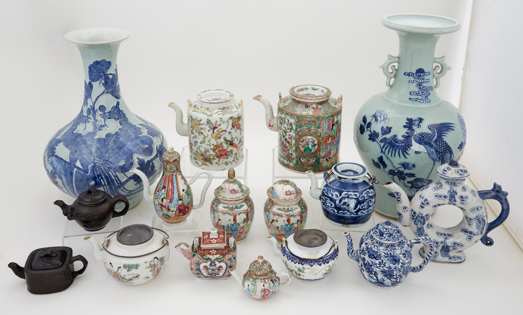 Lot image - Miscellaneous Group of Fourteen Chinese Porcelain and Pottery Teapots; Together with Two Chinese Porcelain Vases