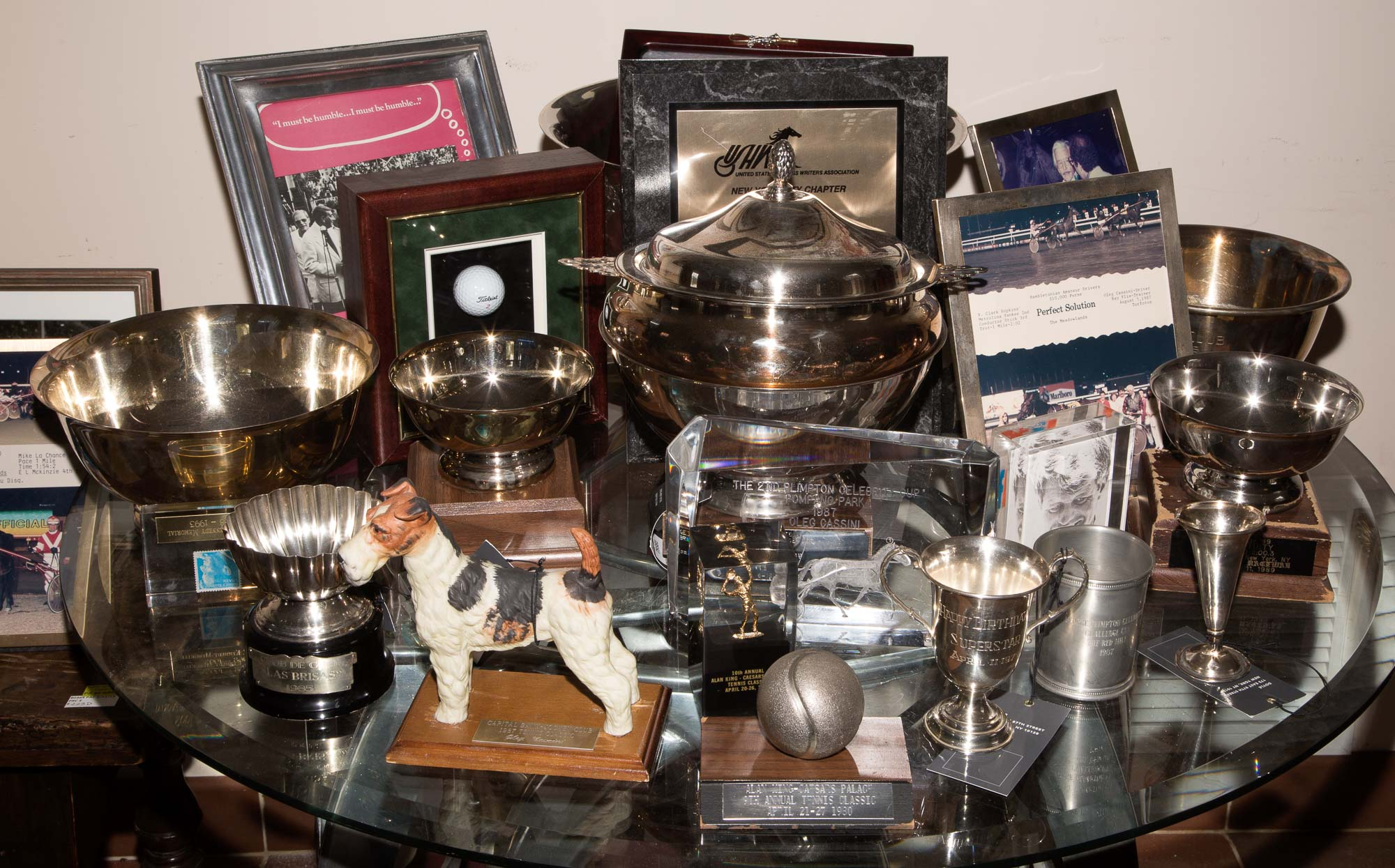 Lot image - [CASSINI-SPORTING]  Group of miscellaneous trophies, desk ornaments and photographs related to Cassinis horse racing, golf, and tennis interest.