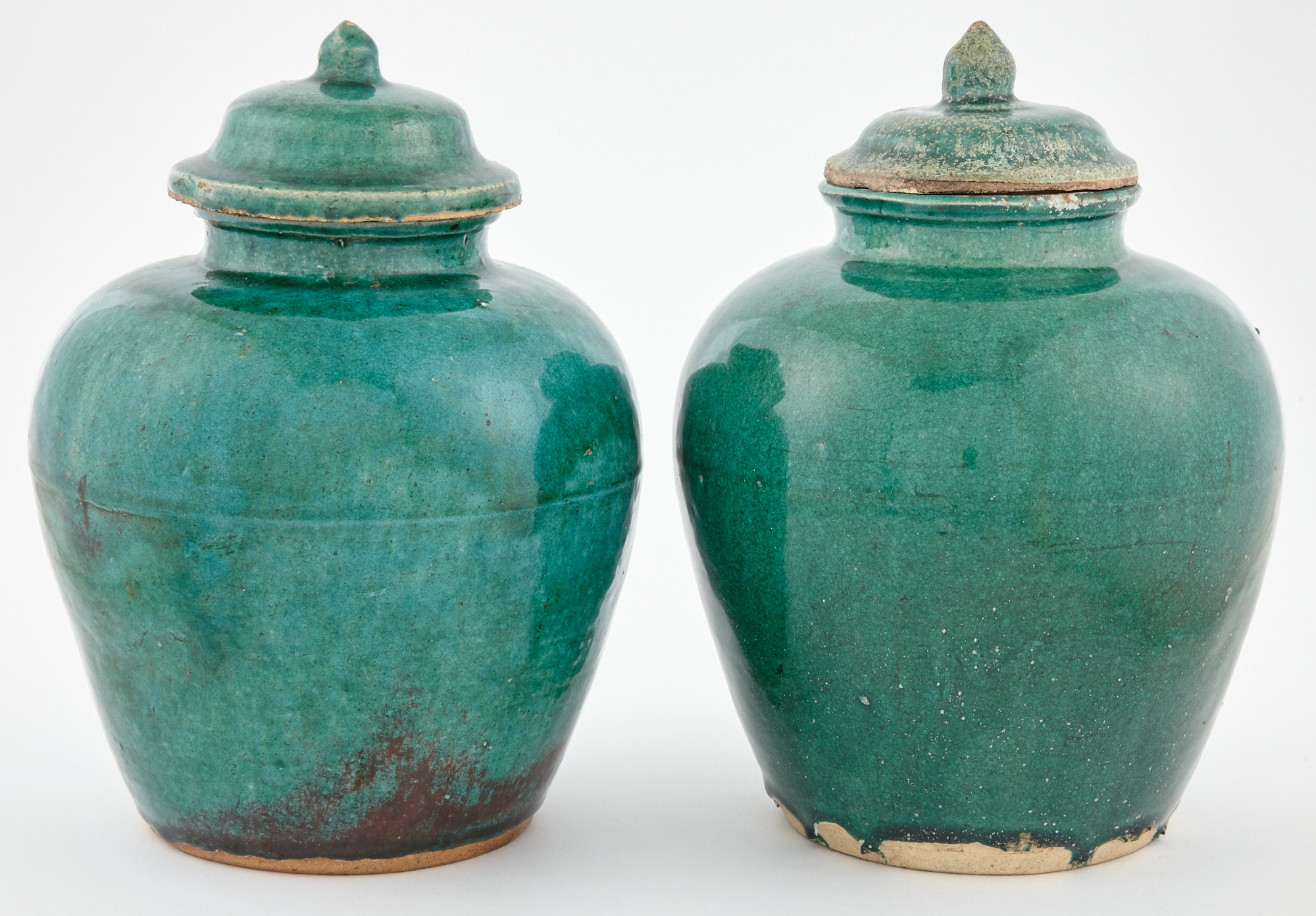 Lot image - Pair of Chinese Green Glazed Pottery Jars and Covers