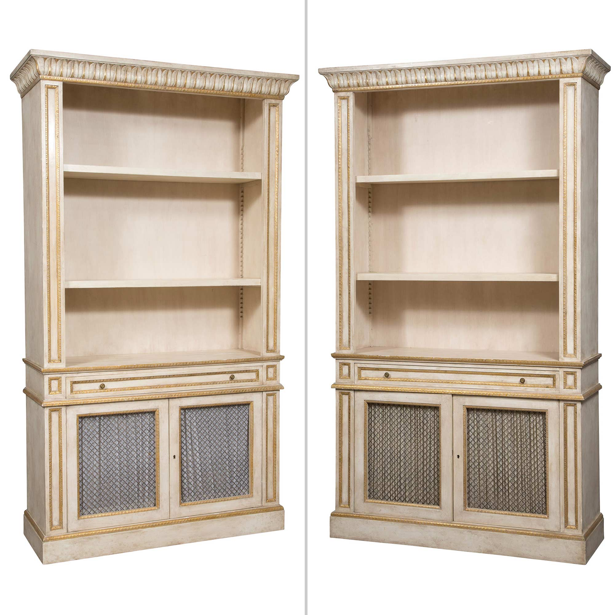 Lot image - Pair of Painted and Parcel-Gilt Bookcase Cabinets