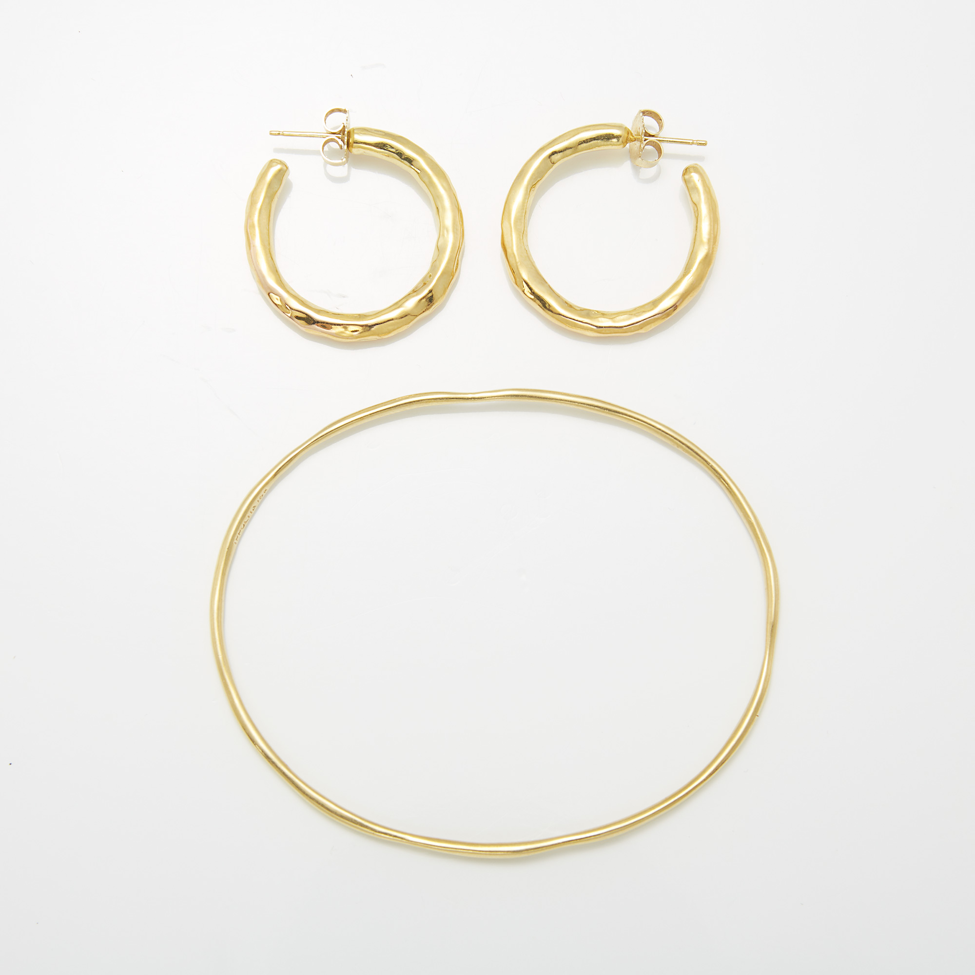 Lot image - Gold Bangle Bracelet, Ippolita, and Pair of Hammered Gold Hoop Earrings