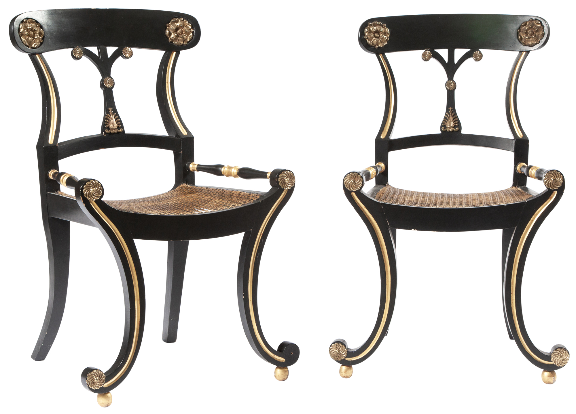 Lot image - Pair of Regency Black-Painted, Parcel-Gilt and Brass-Mounted Caned Side Chairs