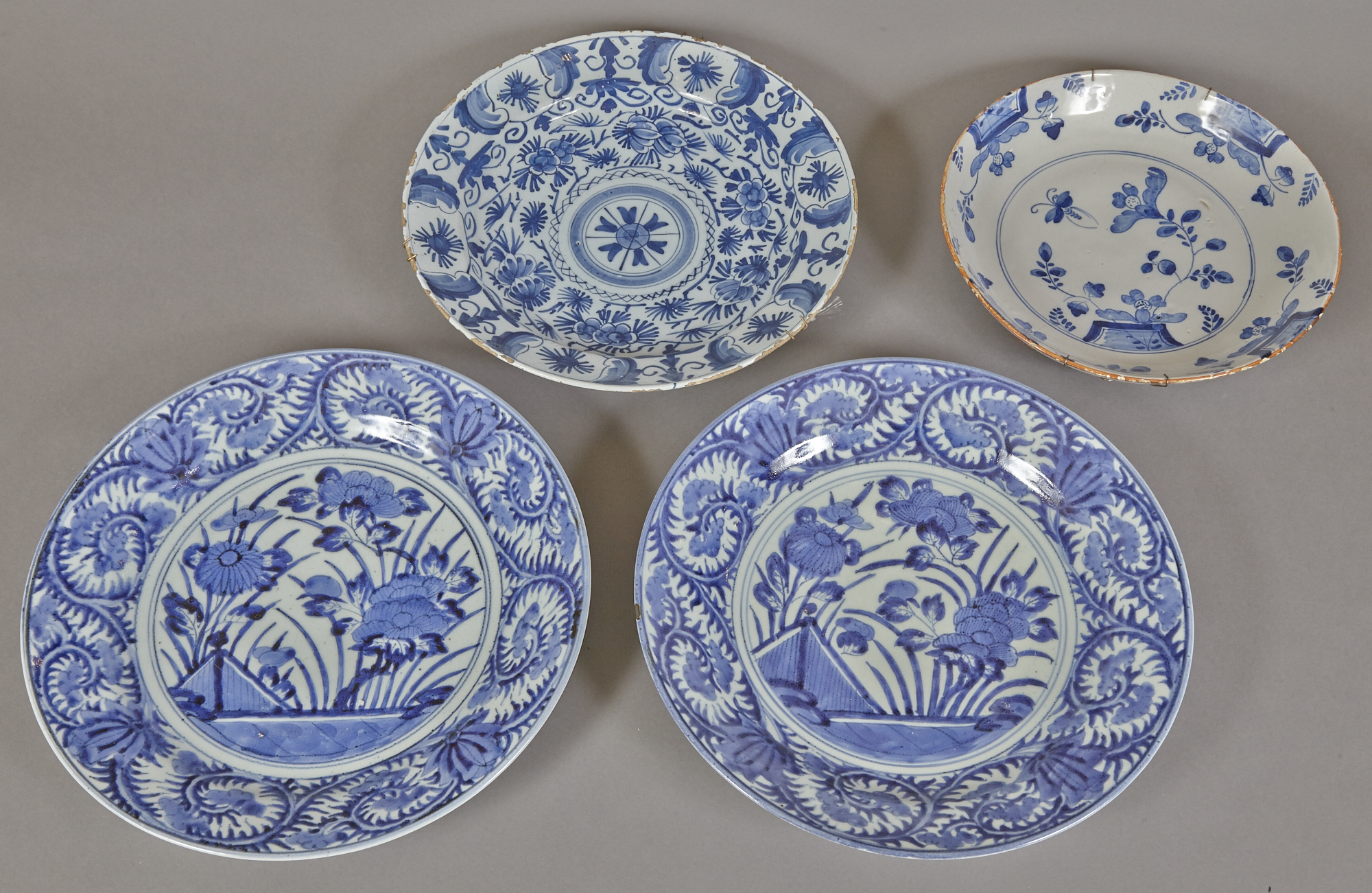 Lot image - Four Delft Pottery Chargers