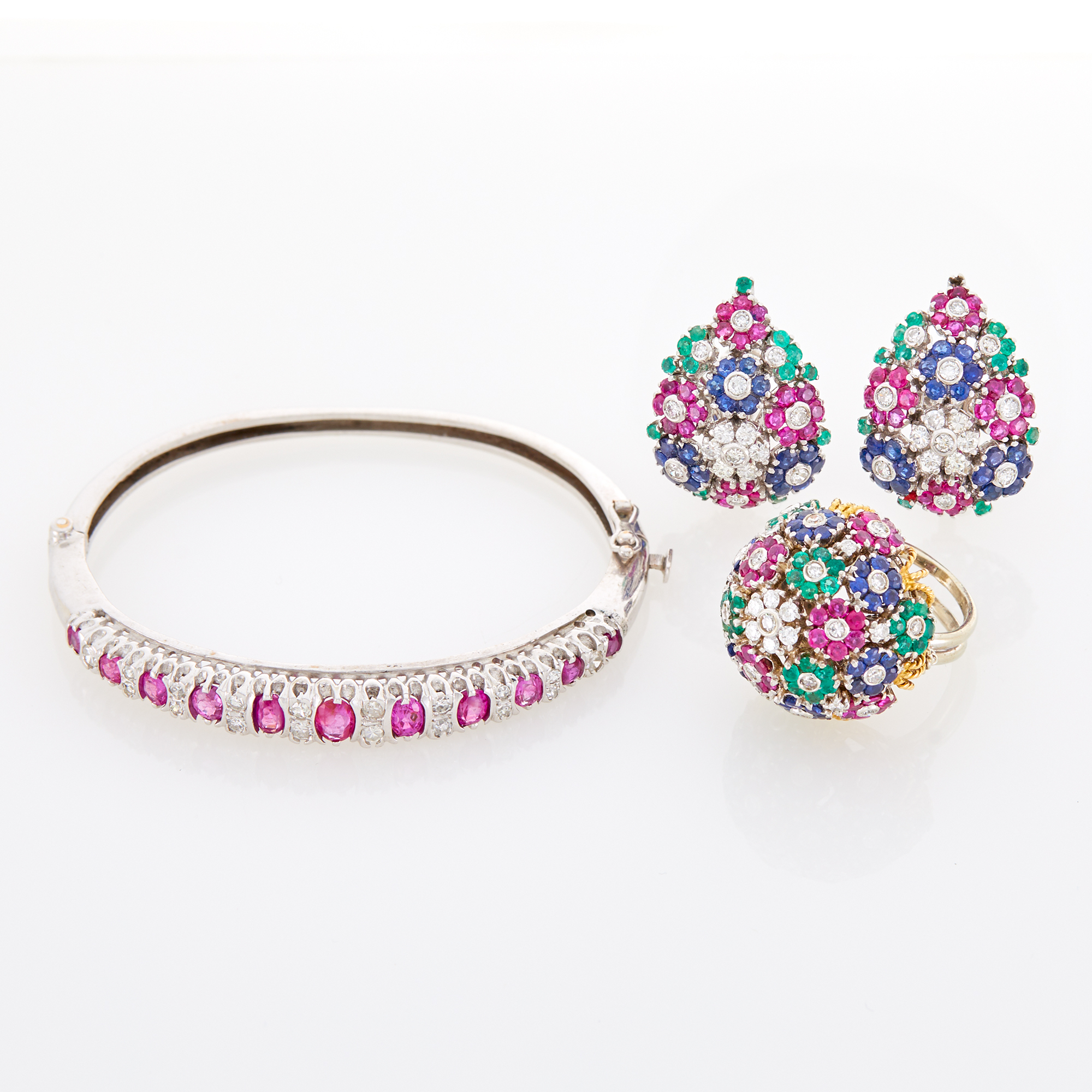 Lot image - White Gold, Ruby and Diamond Bangle Bracelet and Pair of Diamond and Gem-Set Floret Earclips and Dome Ring