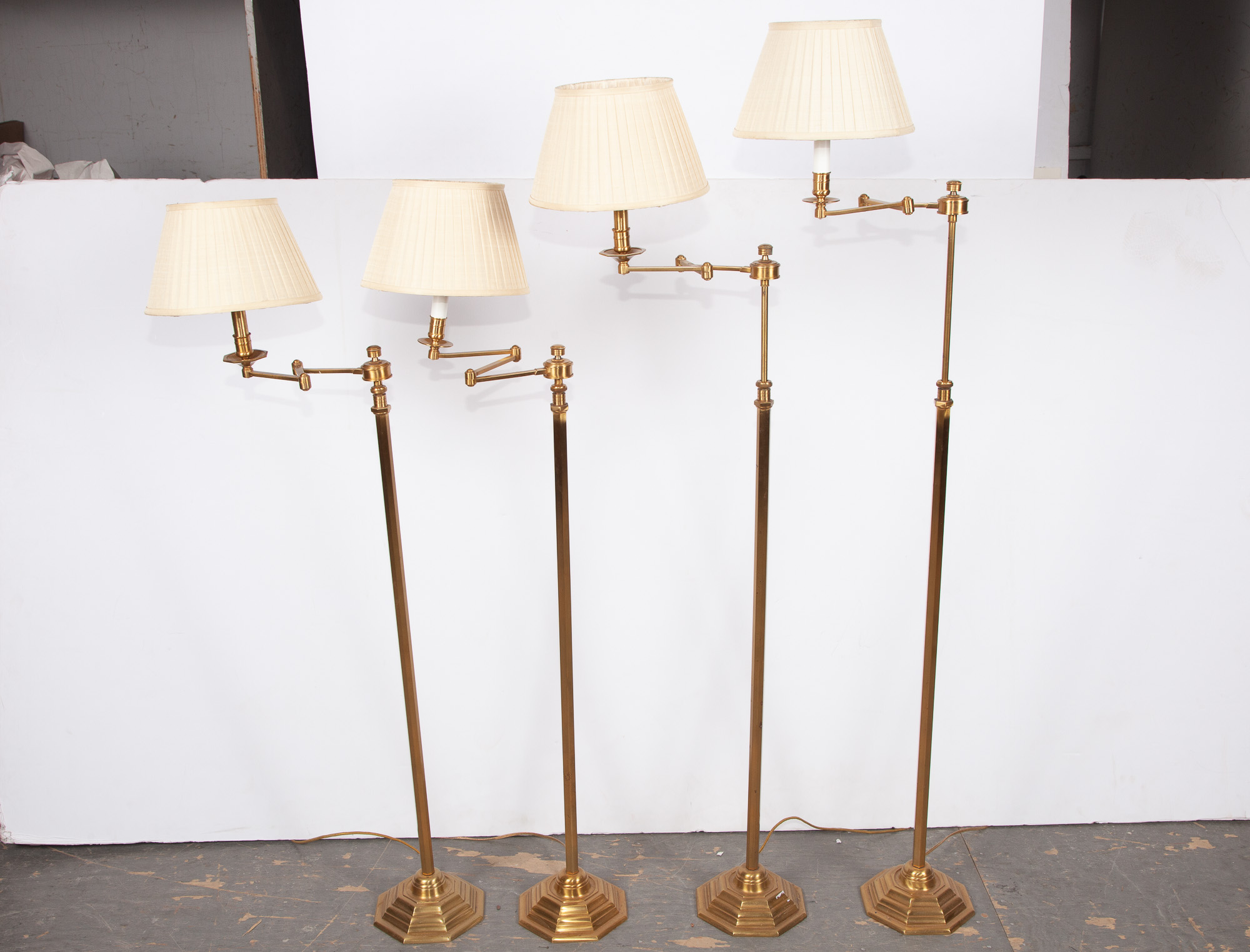Lot image - Group of Four Brass Swing-Arm Floor Lamps
