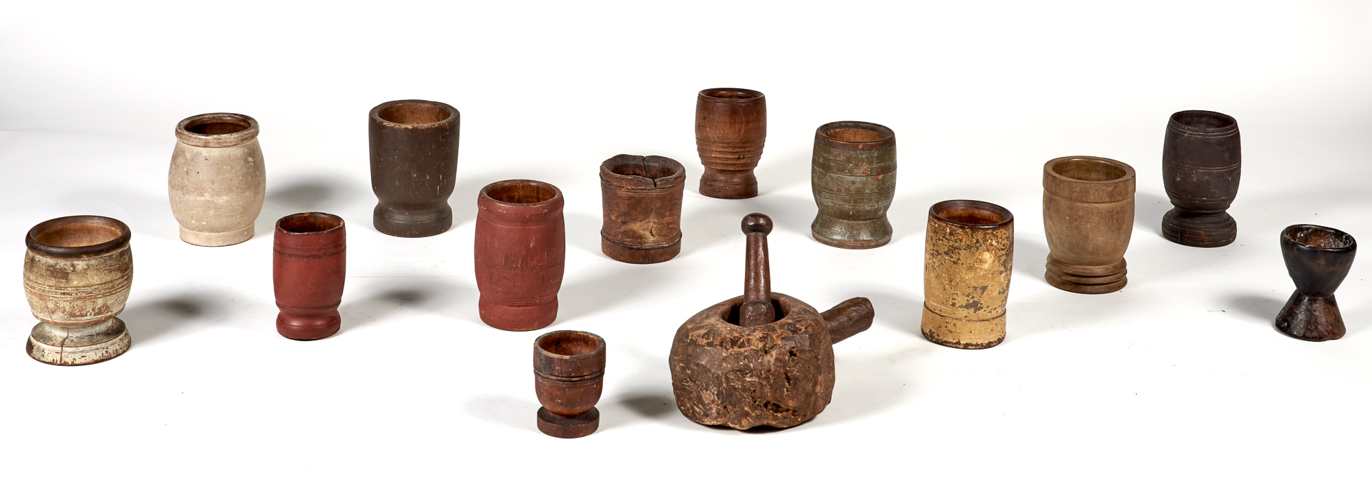Lot image - Group of Thirteen Carved and Turned Wood Mortars