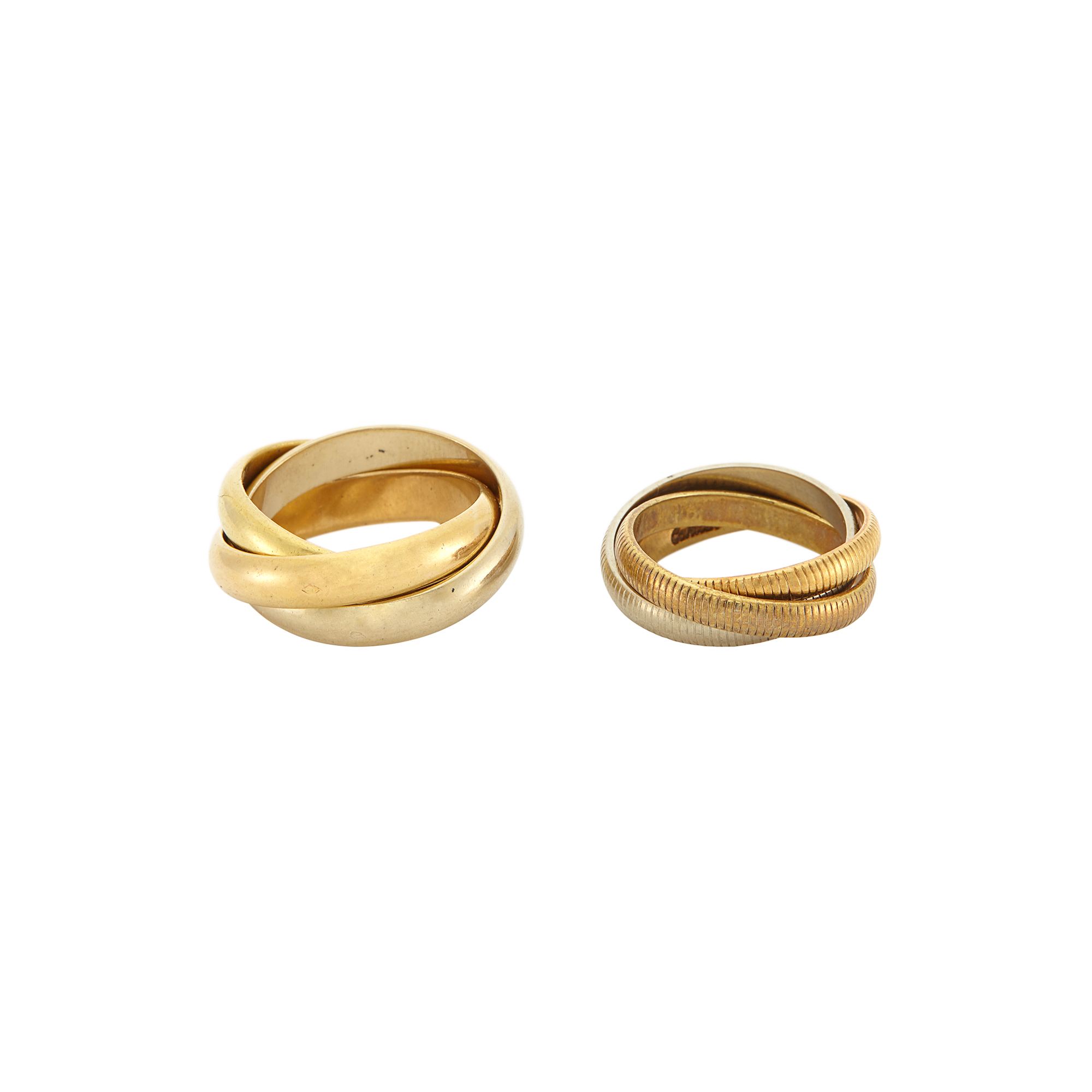 Lot image - Two Tricolor Gold Trinity Band Rings, Cartier
