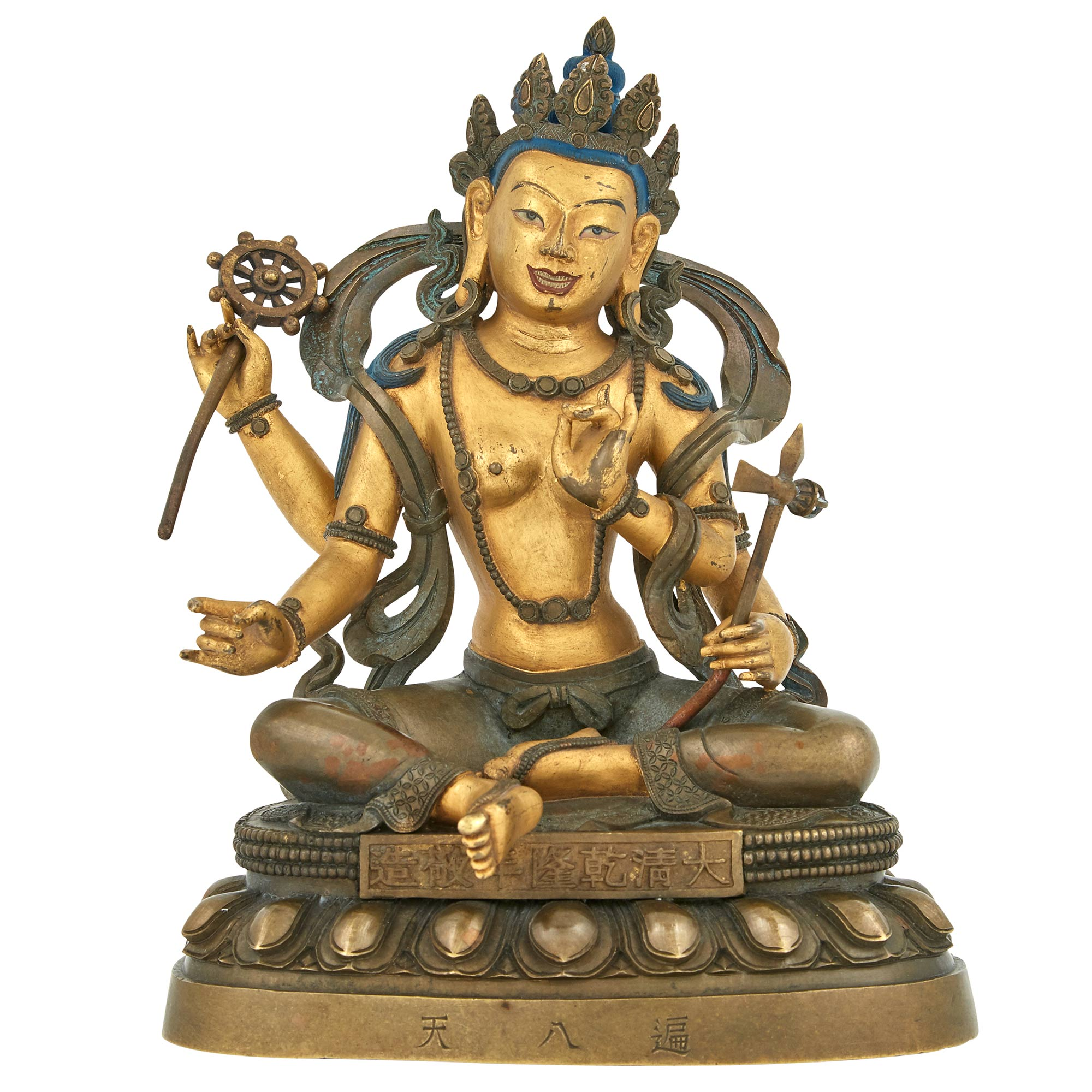 Lot image - Tibetan Parcel-Gilt Figure of a Seated Deity