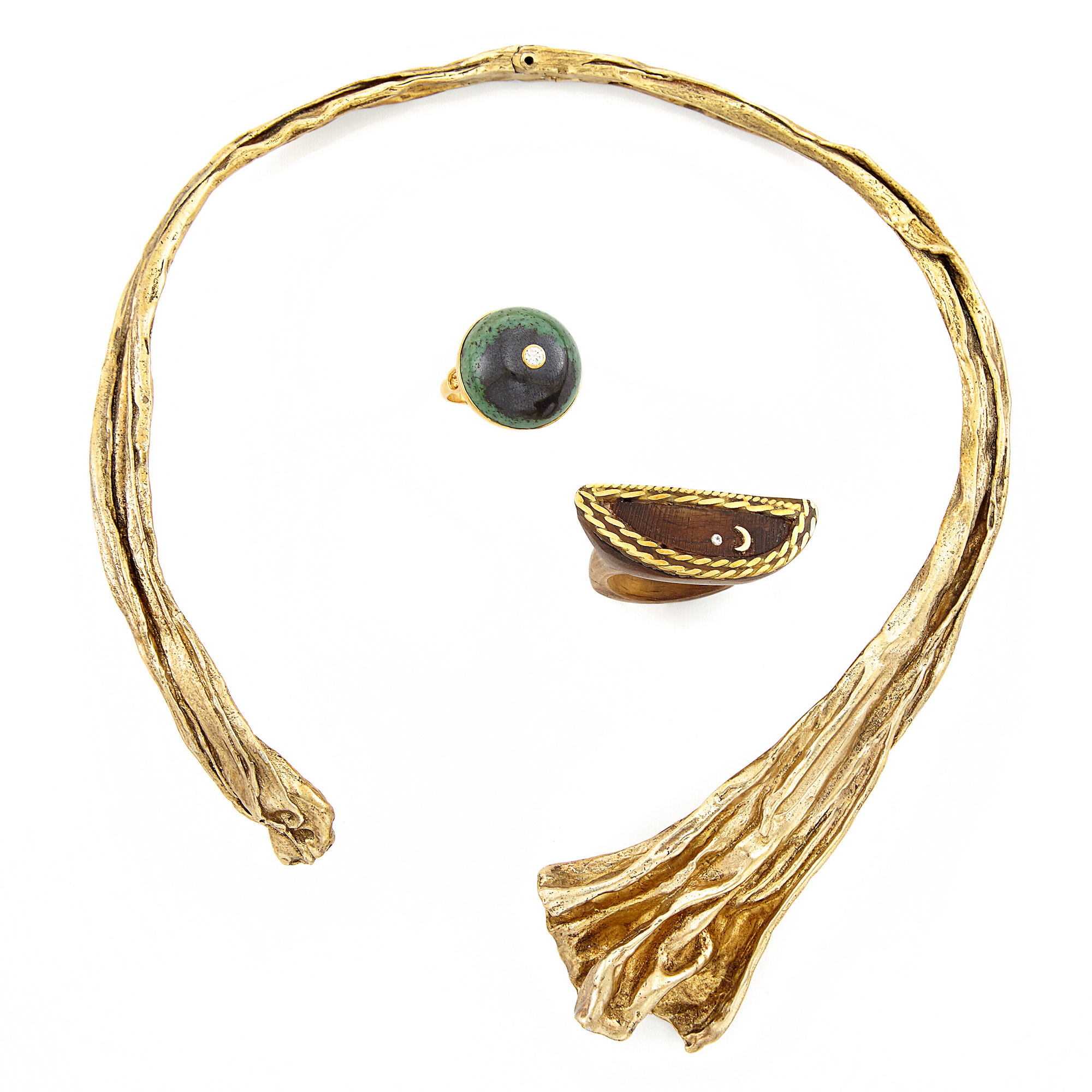Lot image - Gilt-Bronze Necklace, Gold, Hardstone and Diamond Ring, and Wood and Gold Crescent Ring