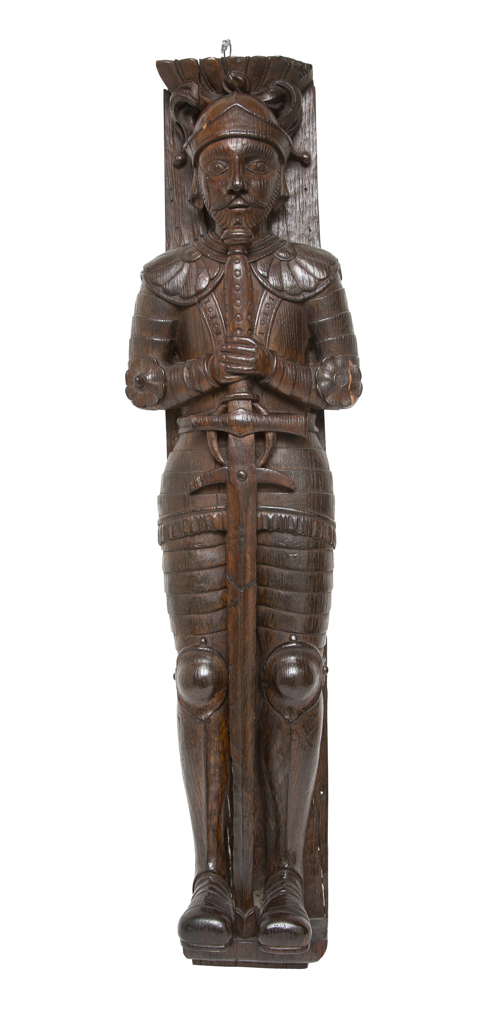 Lot image - Carved Figural Plaque of a Knight with Sword