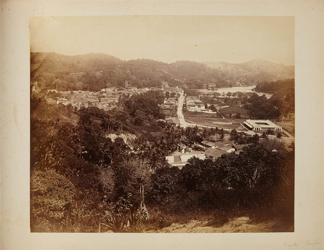 Lot image - [CEYLON]  Album of albumen prints of Ceylon, Burma and India, with an appended section of views of Weston-super-Mare