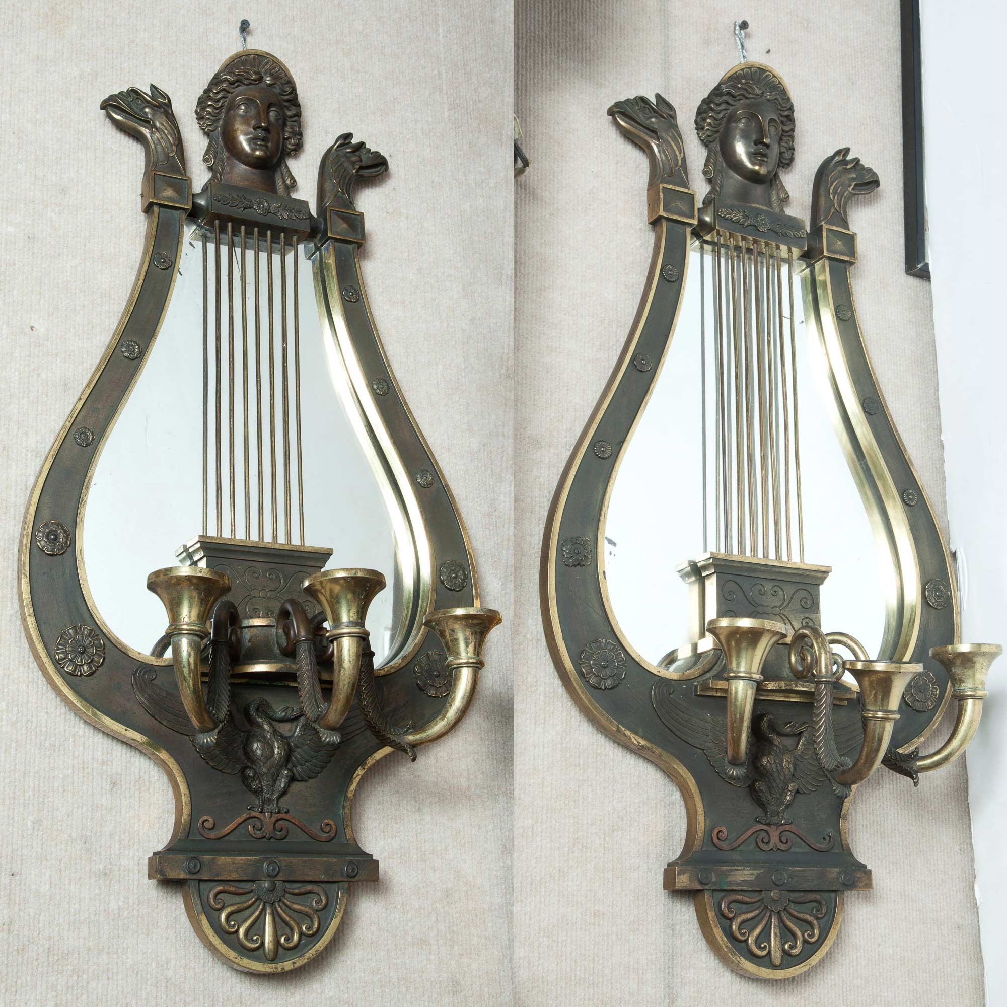 Lot image - Pair of Empire Style Gilt and Patinated Metal Lyre-Form Mirrored Three-Light Wall Lights